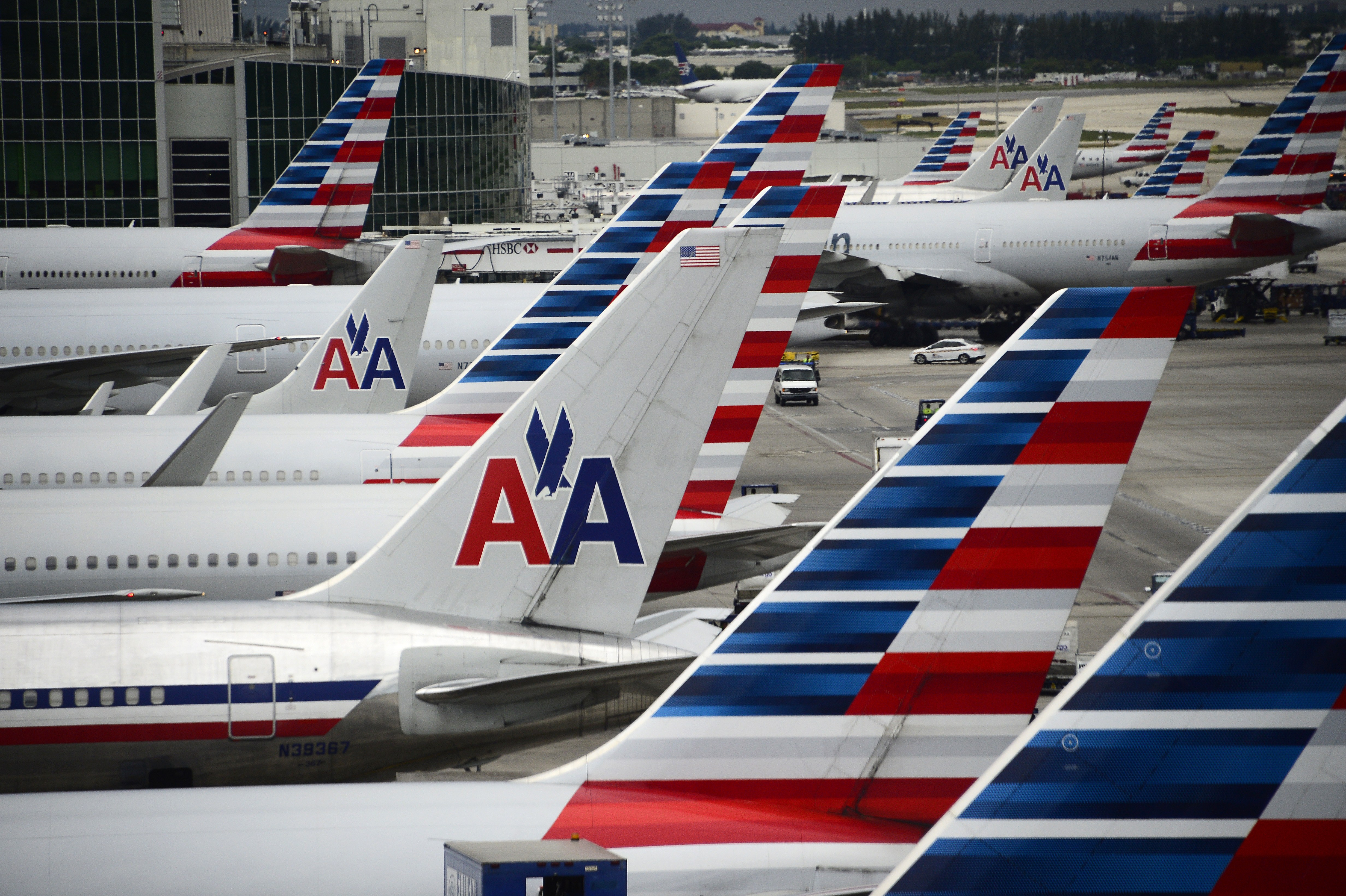 American Airlines passenger planes are seen on the tarmac at Miami International Airport in Miami, Flor. on June 8, 2015.