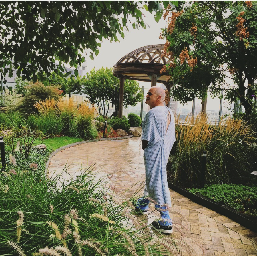 Hours before a second brain surgery in a single week, Andrew Deziel (the author's father) finds solace in the Healing Garden at the Smilow Cancer Hospital at Yale New Haven Hospital on Sept. 10, 2015.