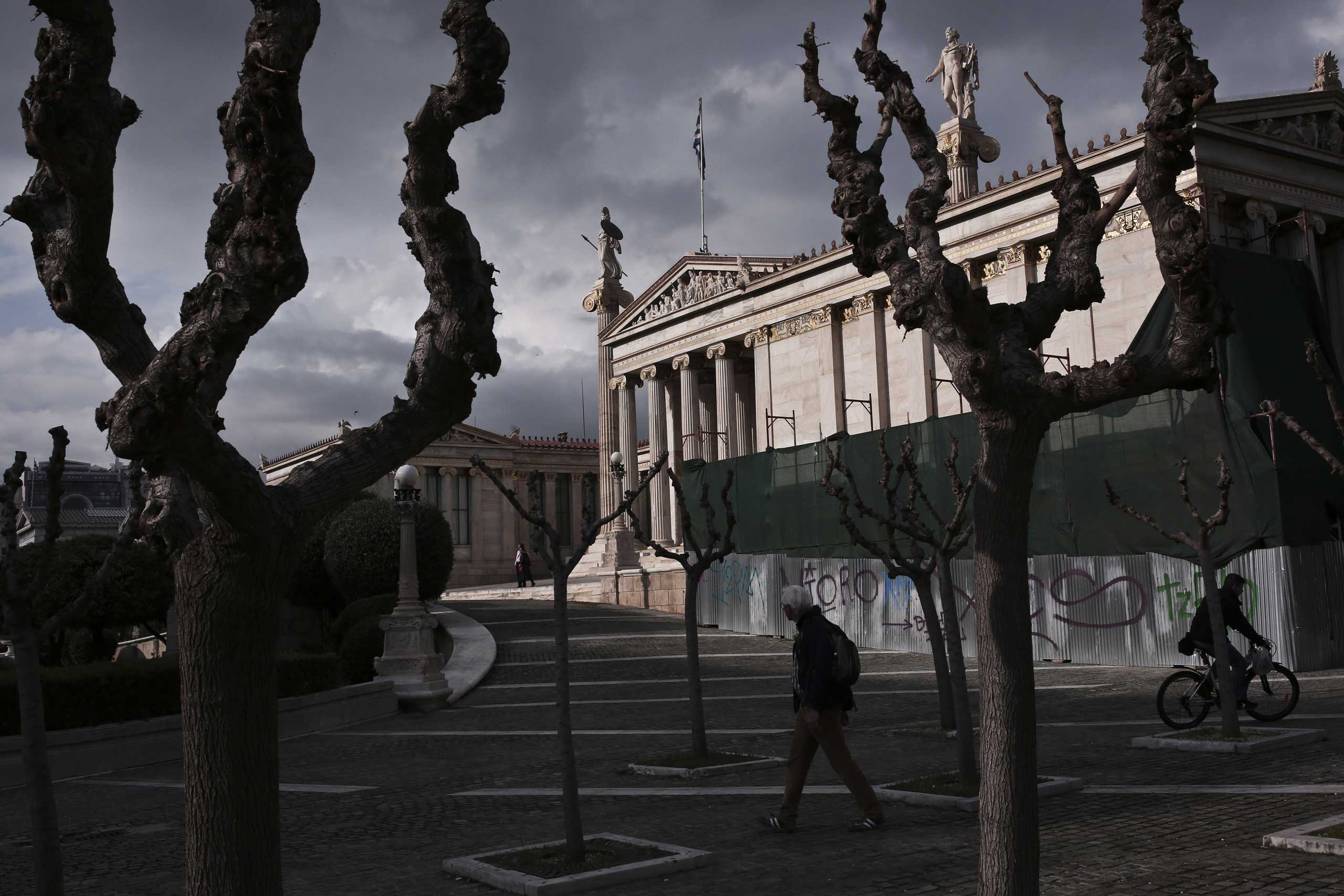 A man walks in front of the Athens Academy in the center of Athens, March 28, 2015.