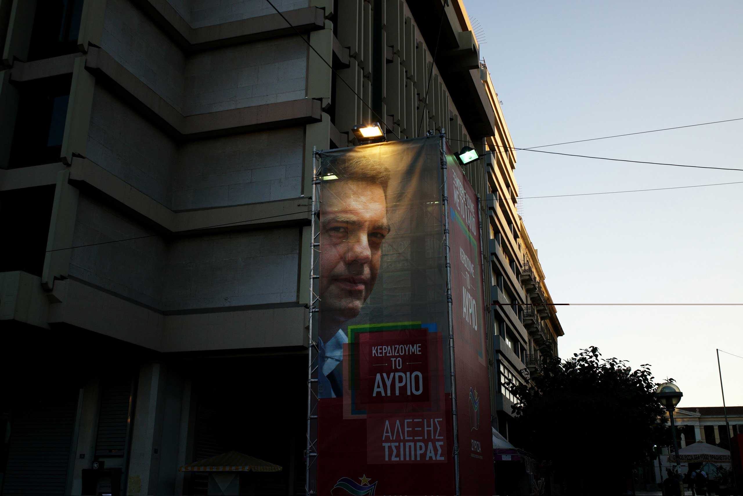A campaign poster of radical left Syriza leader Alexis Tsipras in Athens, on the eve of the Greek general elections, Sept. 19, 2015.