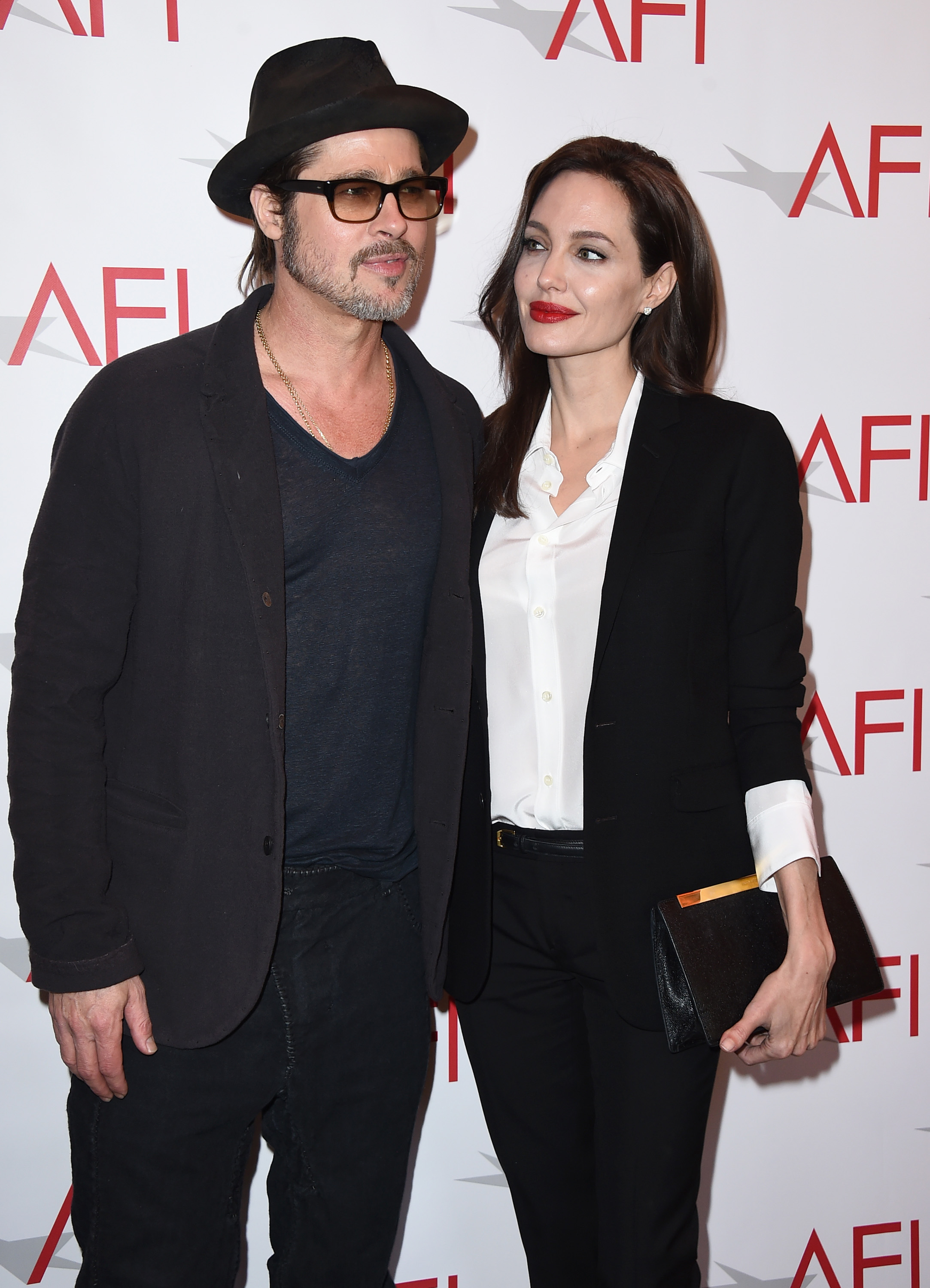 Brad Pitt, left, and Angelina Jolie arrive at the AFI Awards at the Four Seasons Hotel in Los Angeles on Jan. 9, 2015