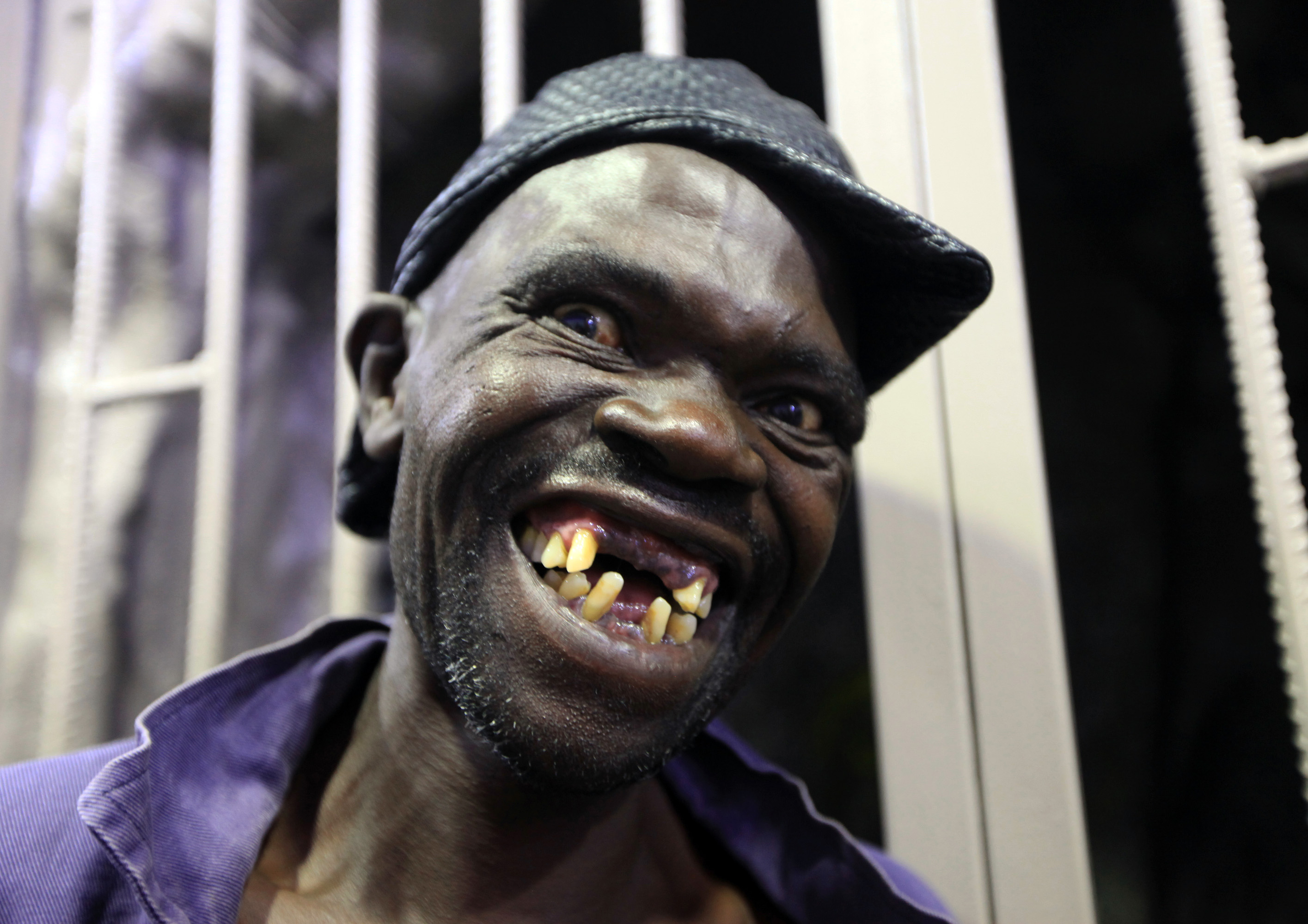 Mison Sere smiles after winning the 2015 Mr. Ugly competition in Harare, Zimbabwe, on Nov. 21, 2015