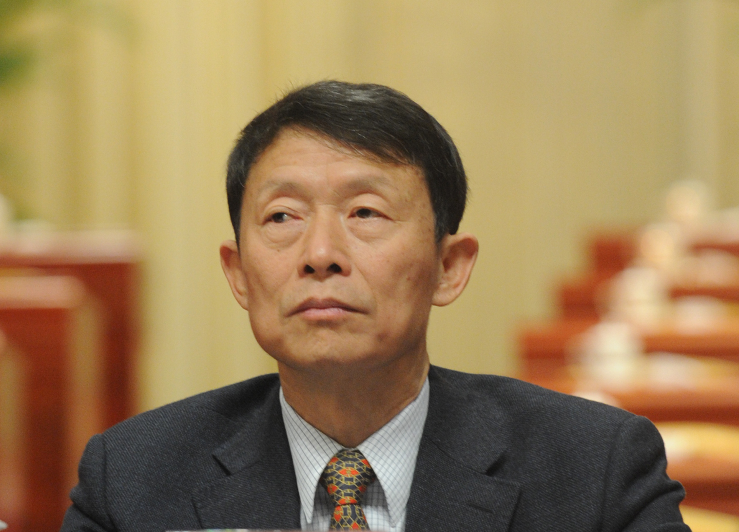 Li Chongxi, then chairman of the Sichuan provincial committee of the Chinese People's Political Consultative Conference, attends a conference in Chengdu, southwest China's Sichuan province, on Jan. 10, 2012