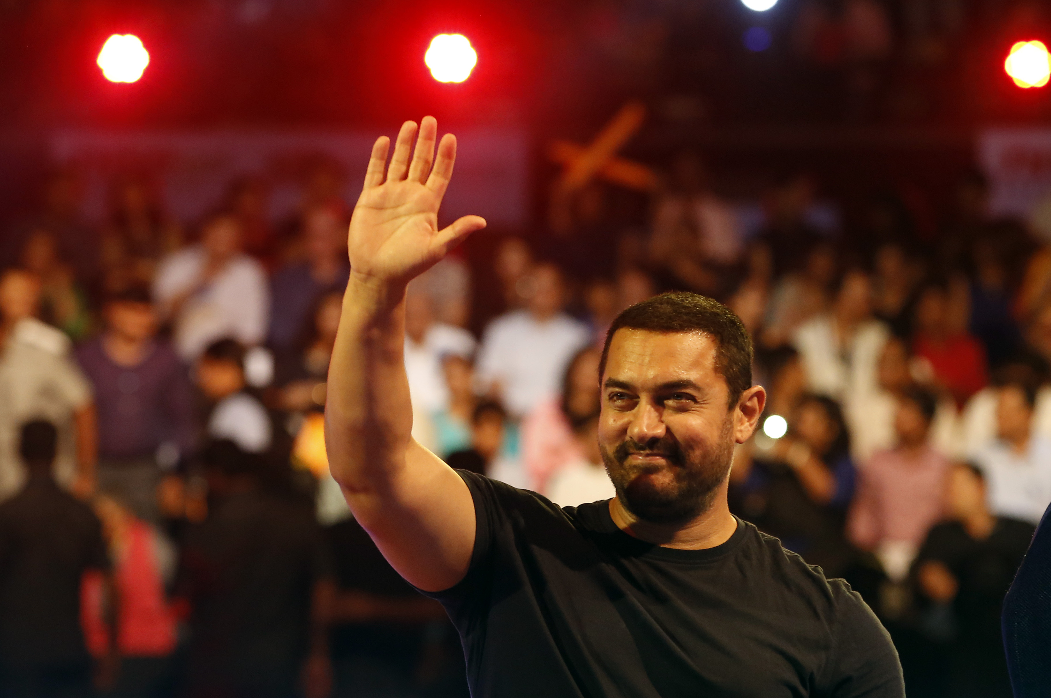 Bollywood actor Aamir Khan waves to the crowd as he attends the inaugural session of Pro Kabaddi League 2015 in Mumbai on July 18, 2015