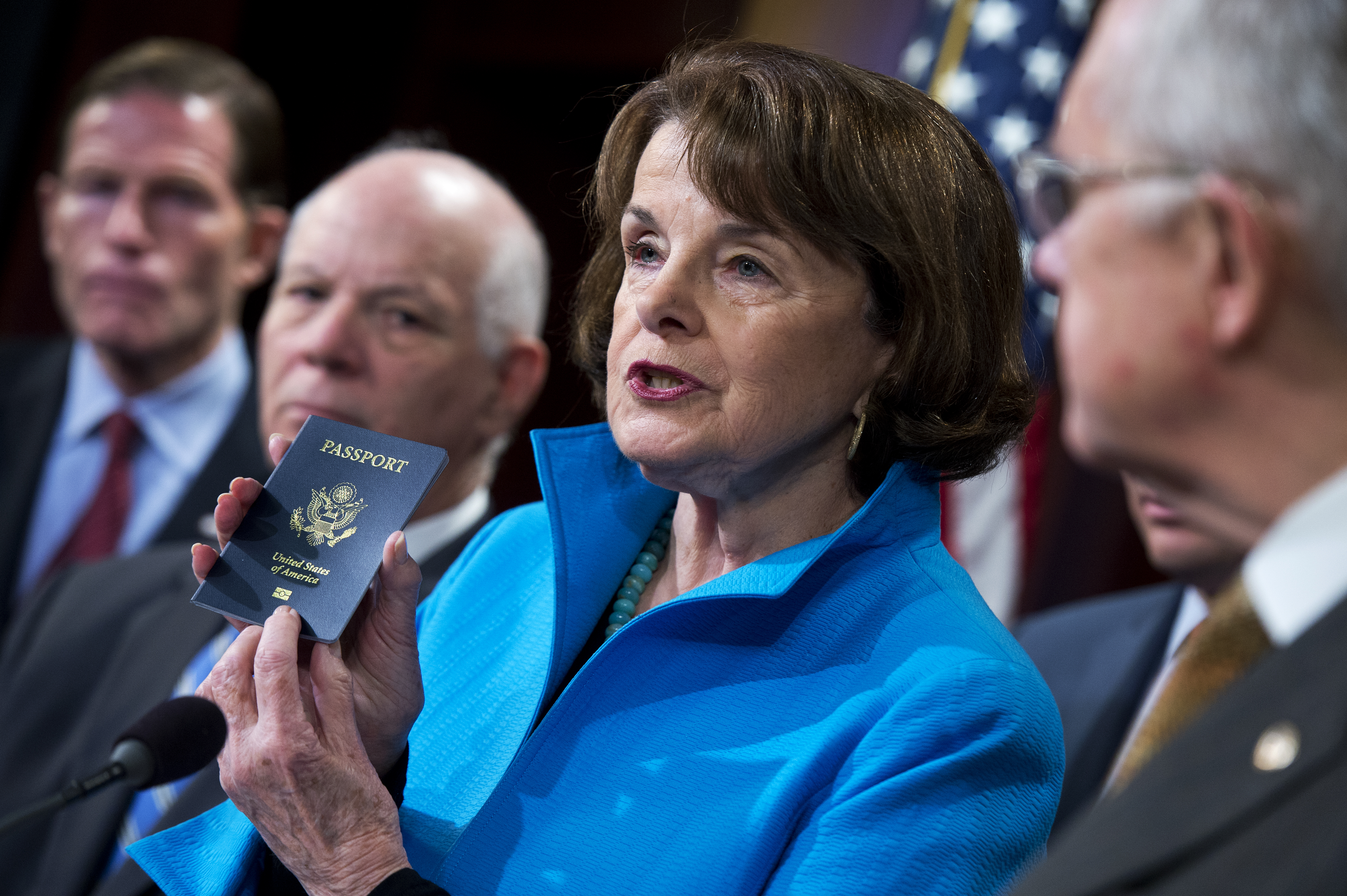 Dianne Feinstein, D-Calif., shows her passport during a news conference on closing loopholes in the Visa Waiver Program, Nov. 19, 2015.