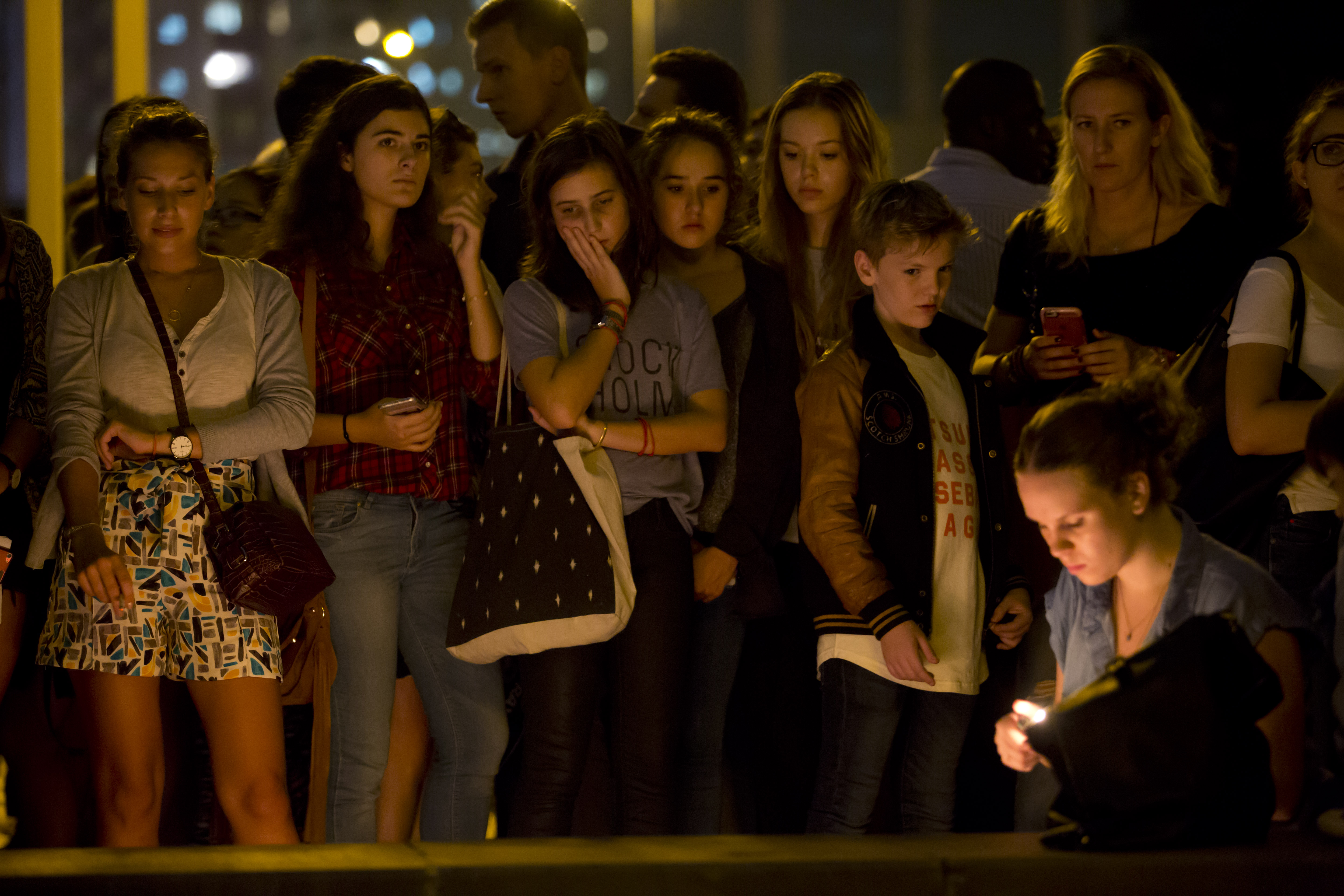 People gather in Hong Kong to mourn for the victims killed in Paris, on Nov. 14, 2015.
