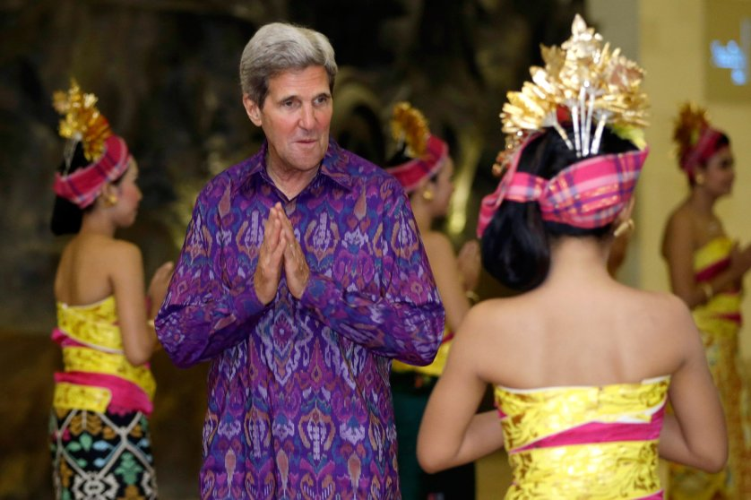 """U.S. Secretary of State John Kerry, wearing a traditional Balinese woven fabric called an """"endek,"""" arrives at a gala for the leaders at the APEC Summit in Nusa Dua on the Indonesian resort island of Bali on Oct. 7, 2013."""