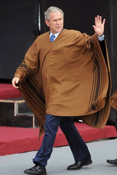 U.S. President George W. Bush, wearing a poncho, arrives for the official photograph for the APEC Summit on Nov. 23, 2008 in Lima.