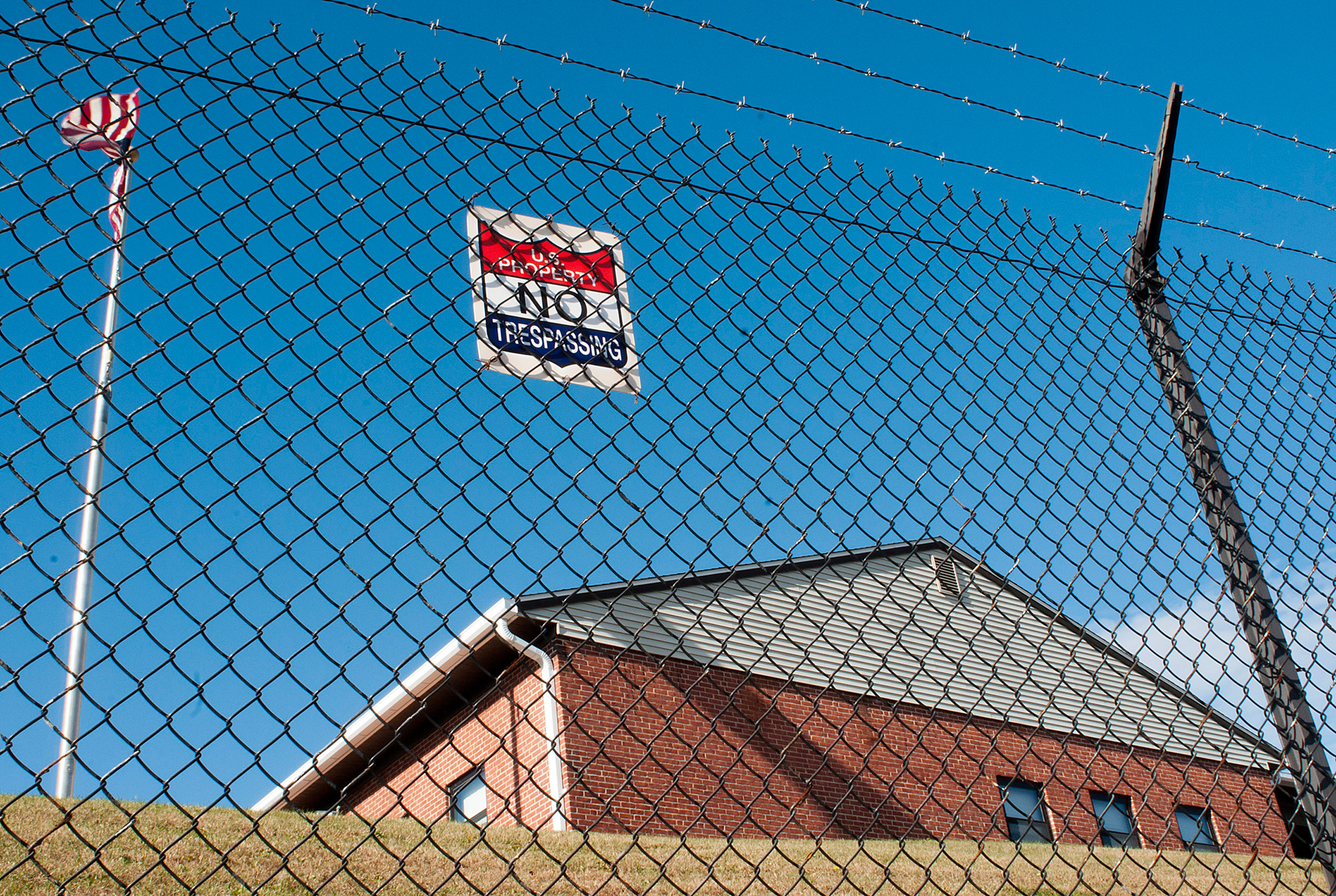 A barbed wire fence protects a U.S. Army Reserve building on North Lake Ave. in Worcester, Mass., on Nov. 16, 2015