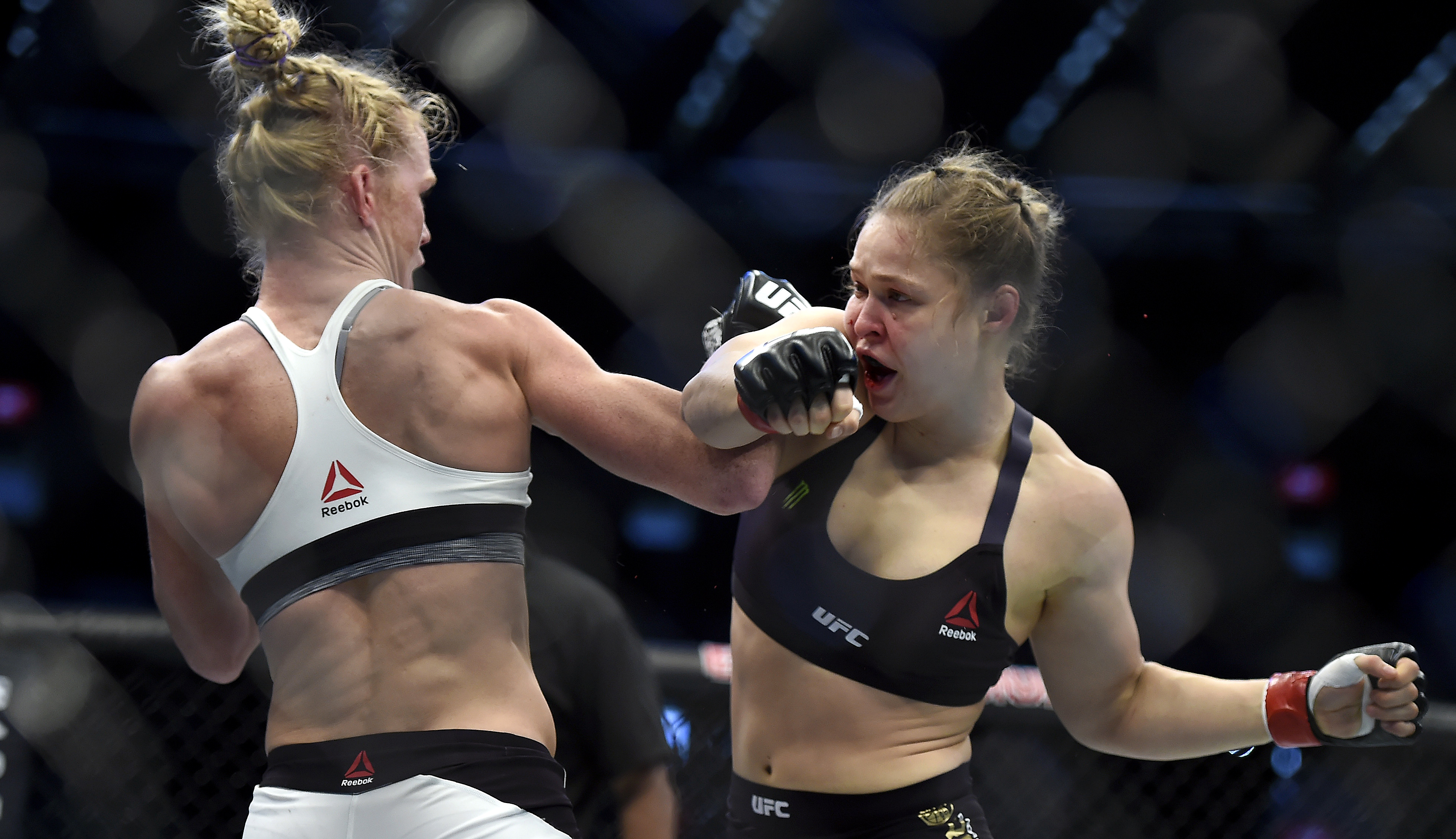 Holly Holm, left, and Ronda Rousey exchange their punches during their UFC 193 bantamweight title fight in Melbourne, Australia, Sunday, Nov. 15, 2015