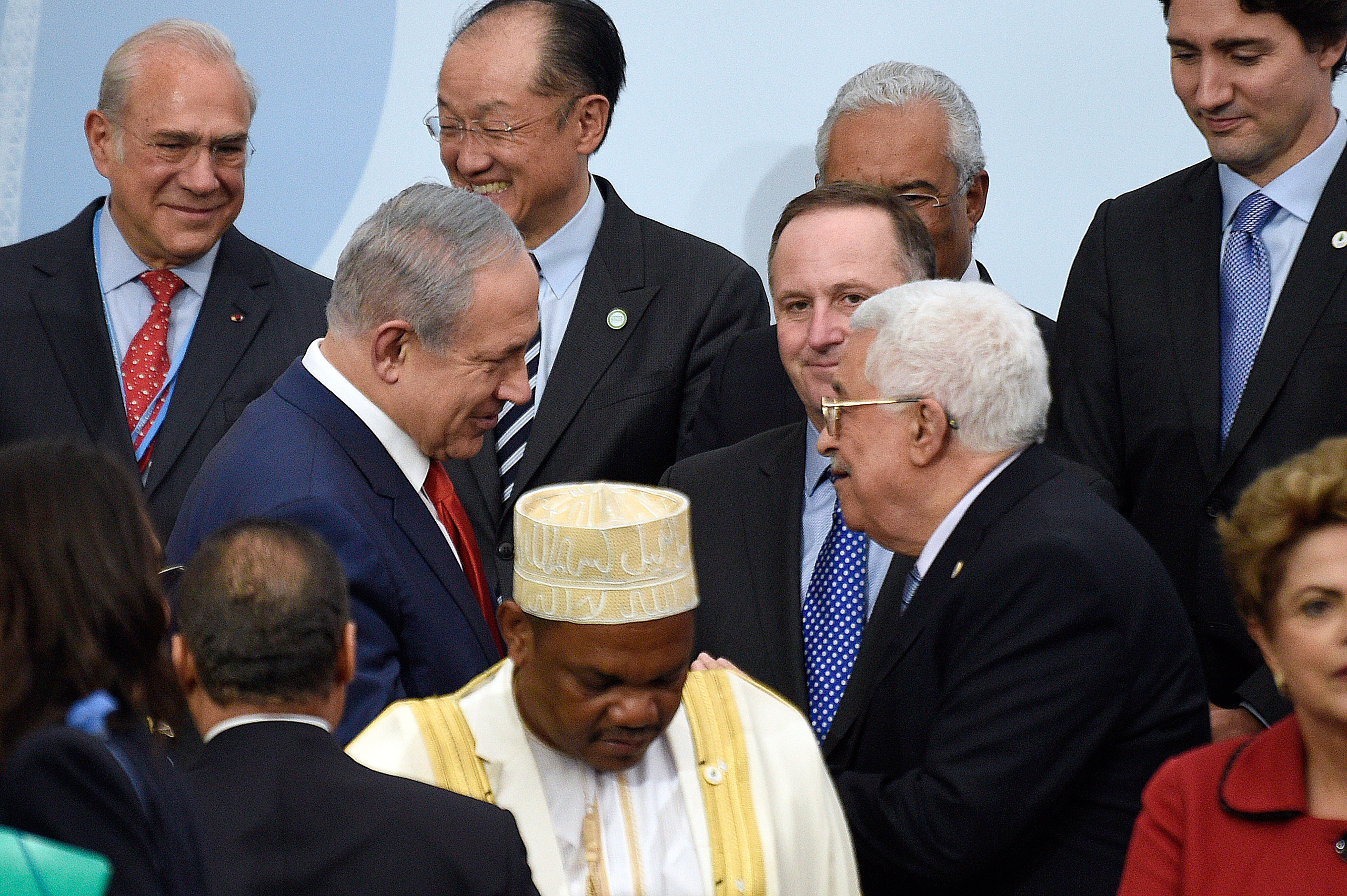 Israeli Prime Minister Benjamin Netanyahu, center left, talks with Palestinian President Mahmoud Abbas, center right, at the COP21 United Nations Climate Change Conference in Le Bourget, France, on Nov. 30, 2015.