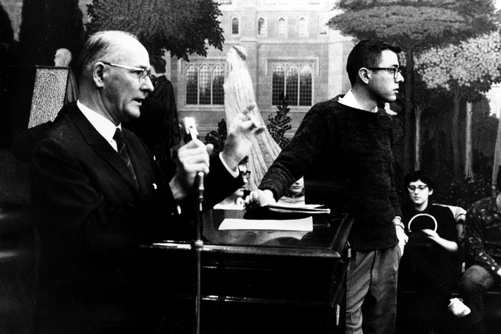 Bernie Sanders, a member of the steering committee, stands next to George Beadle, University of Chicago president, at a CORE meeting on housing sit-ins in 1962.