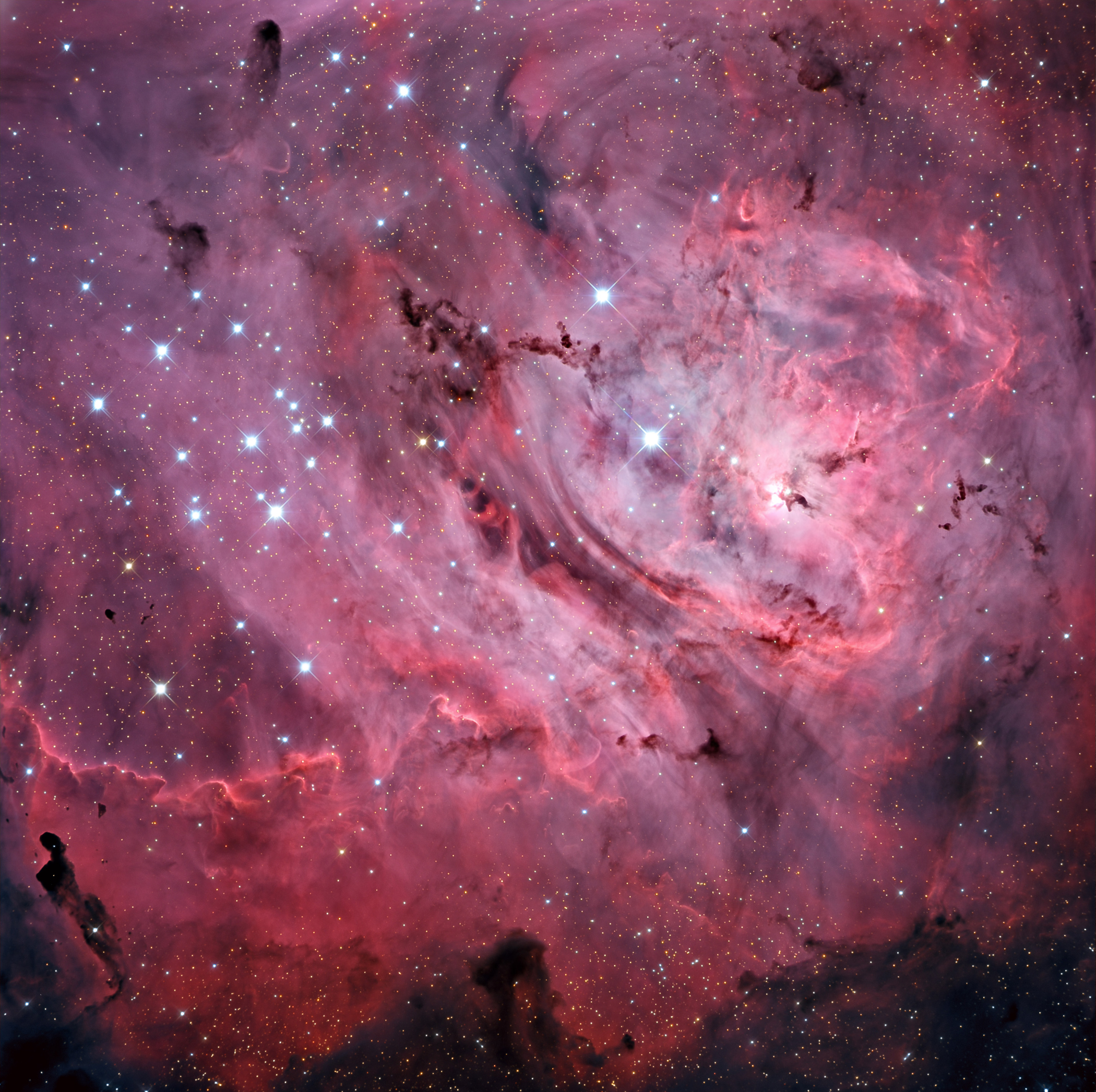 The Lagoon Nebula, a bright cloud of dust and gas 4,000 light years away and 40 light years across, glows brilliantly due to hot energetic young stars forming within. It can even be glimpsed with the unaided eye under dark skies away from city lights.  The photo was captured at the Mount Lemmon SkyCenter in Arizona and released on July 15, 2015.