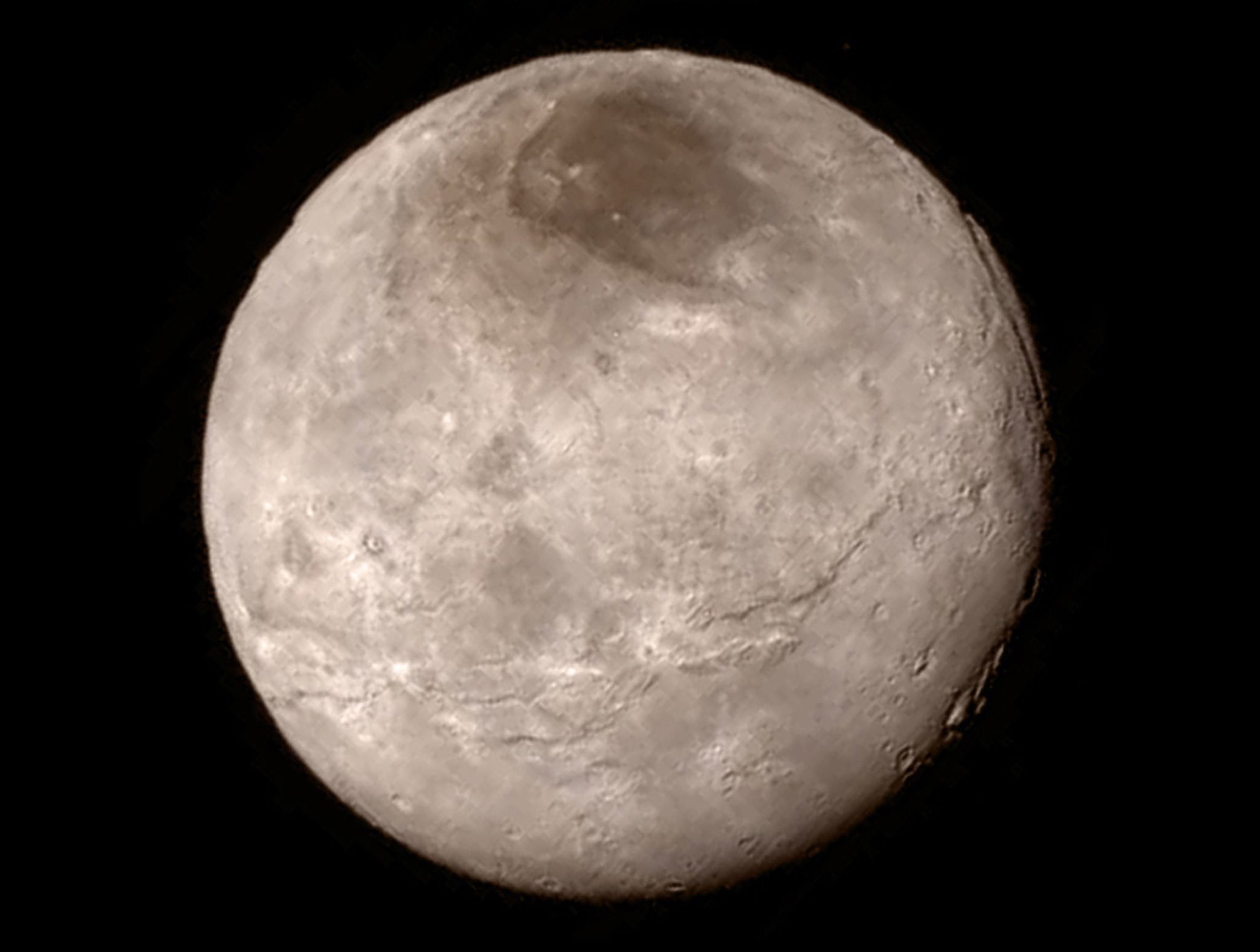 Charon, the largest moon of Pluto, captured by the New Horizons spacecraft on July 13, 2015 from a distance of 290,000 miles.