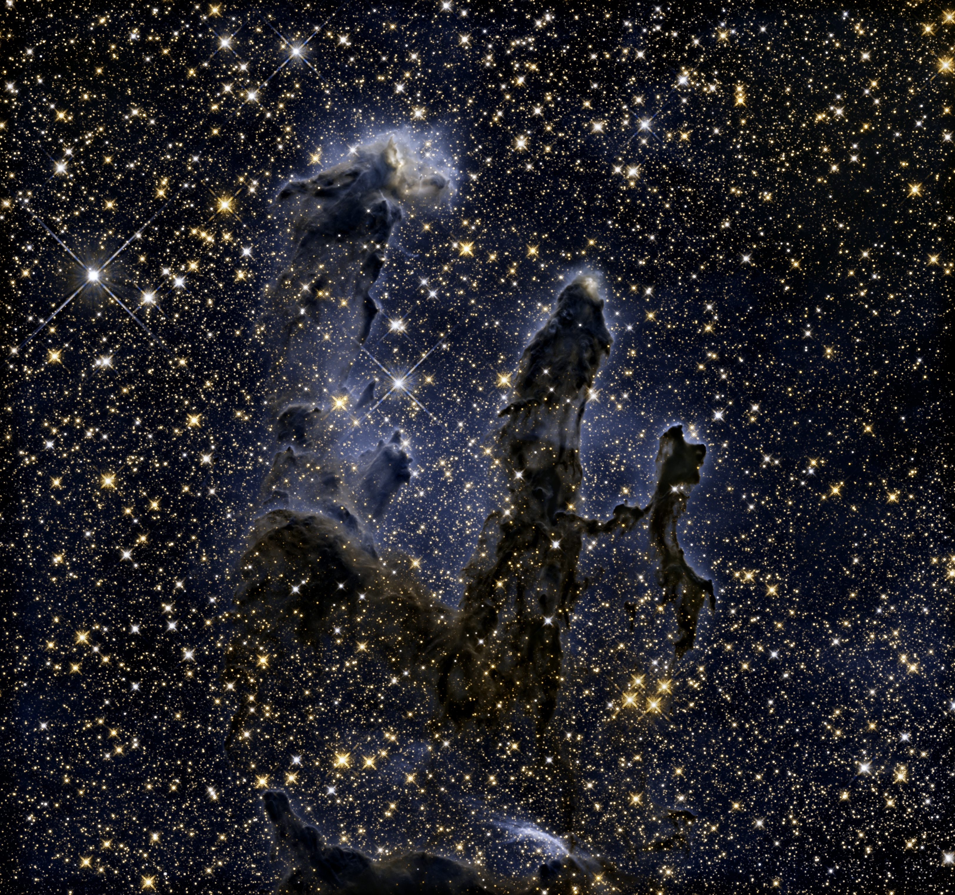The Hubble Space Telescope revisits one of its most iconic and popular images: the Eagle Nebula's Pillars of Creation. This image shows the formation as seen in infrared light, which gives the familiar pillars an unfamiliar look.  The image was released in January 2015.