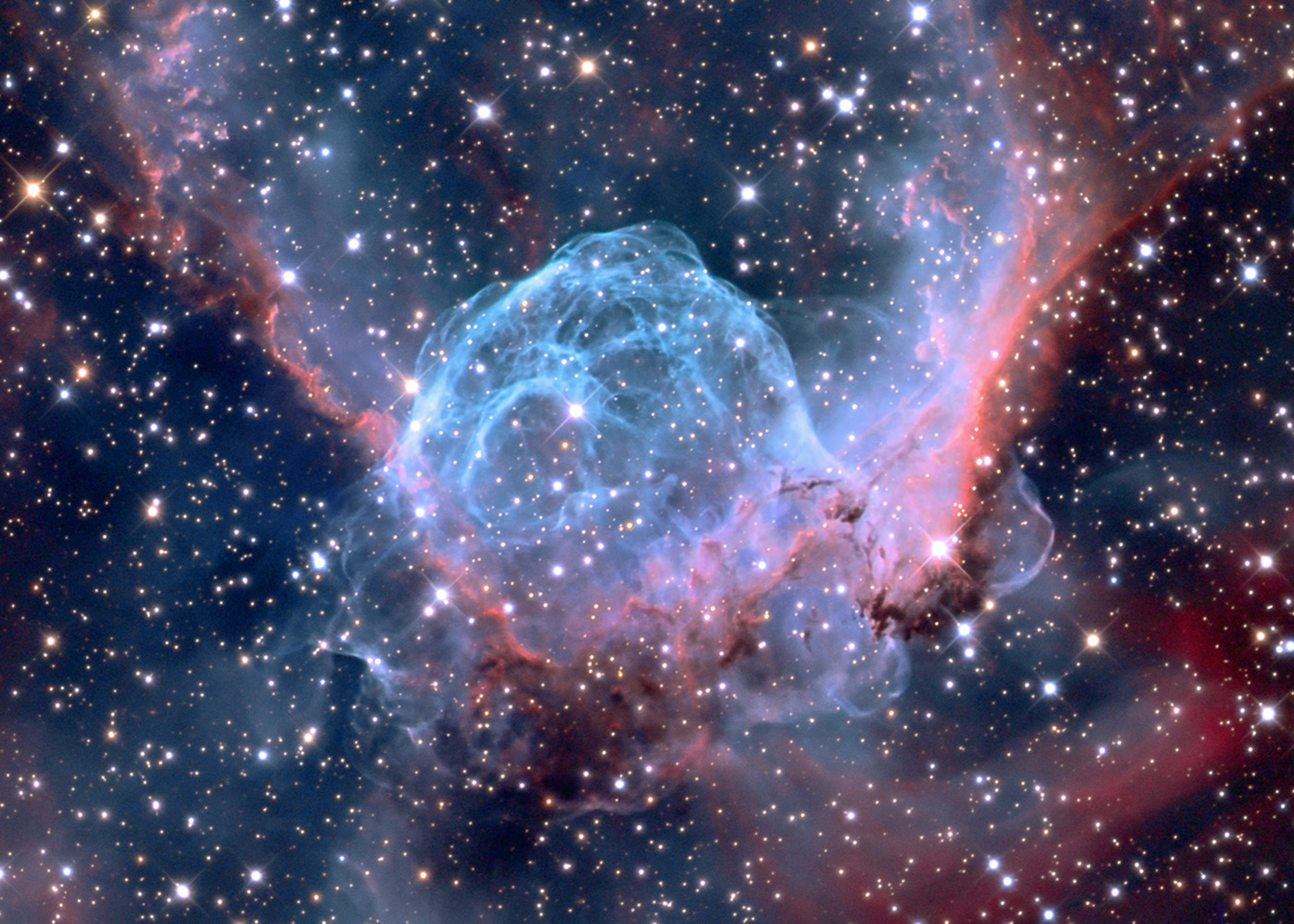 "This nebula named ""Thor's Helmet"" is powered by a central ""Wolf Rayet"" star whose explosive tantrums blow huge bubbles of gas and make them glow like neon. This star is easily 20 times the mass of the Sun and located 15,000 light years away. Eventually the star's instability will lead it to explode as a supernova.  The photo was captured at the Mount Lemmon SkyCenter in Arizona and released on Jan. 3, 2015."