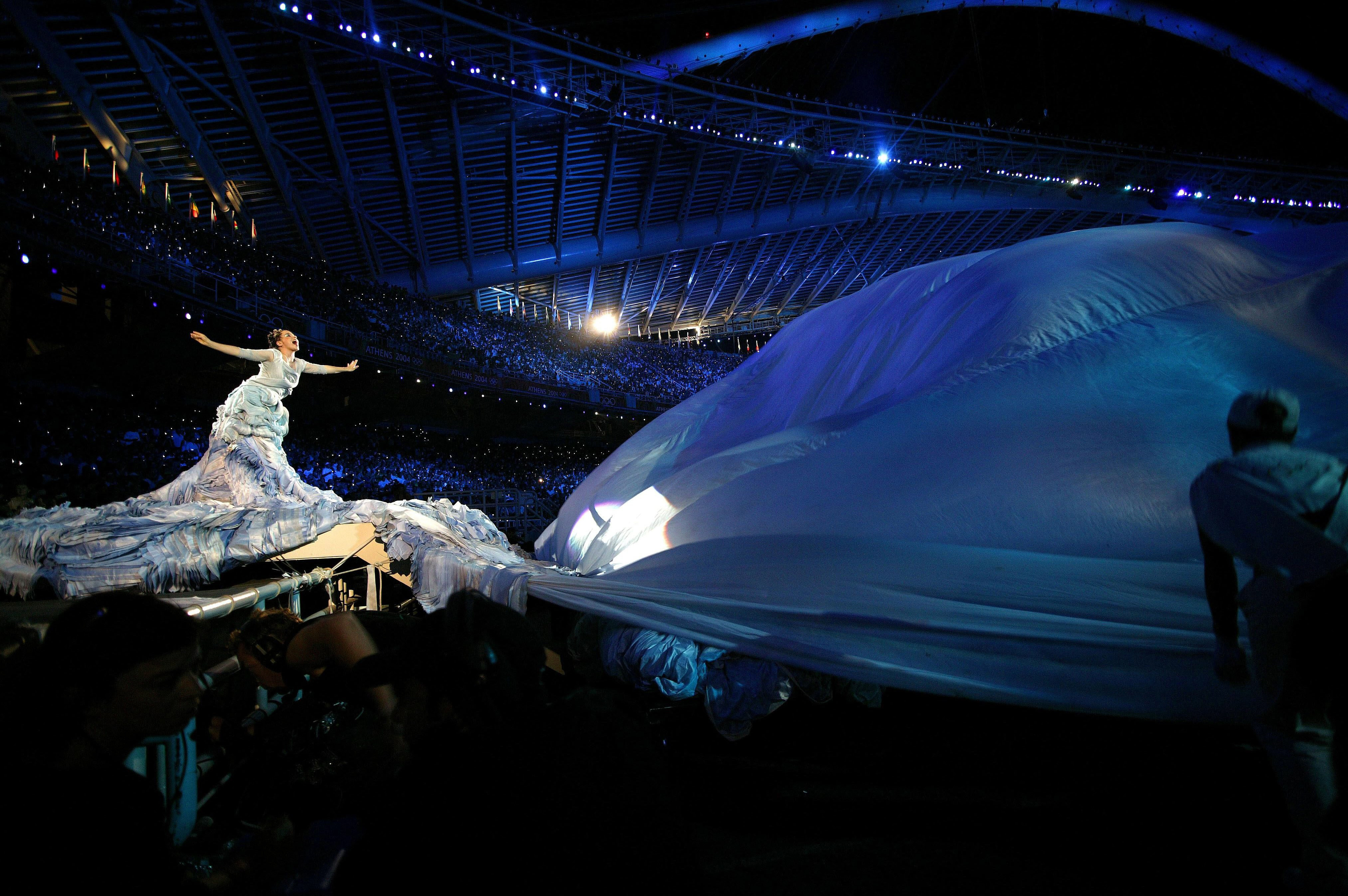Björk performs onstage at the opening of the 2004 Athens Olympics in Athens, Greece on Aug. 13, 2004.