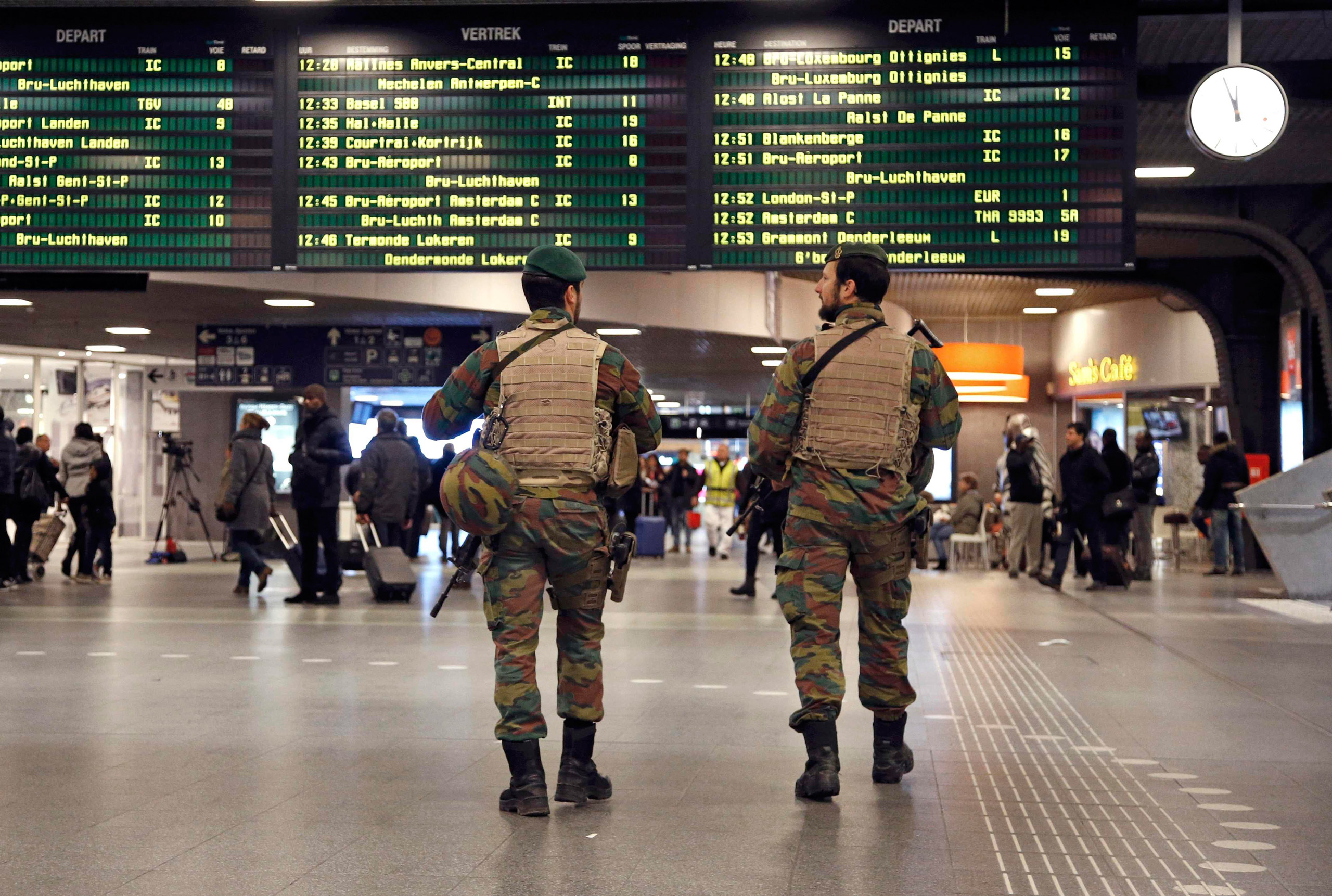 Belgian soldiers patrol in the arrival hall at Midi railway station, after security was tightened following the fatal attacks in Paris, in Brussels, on Nov. 21, 2015,