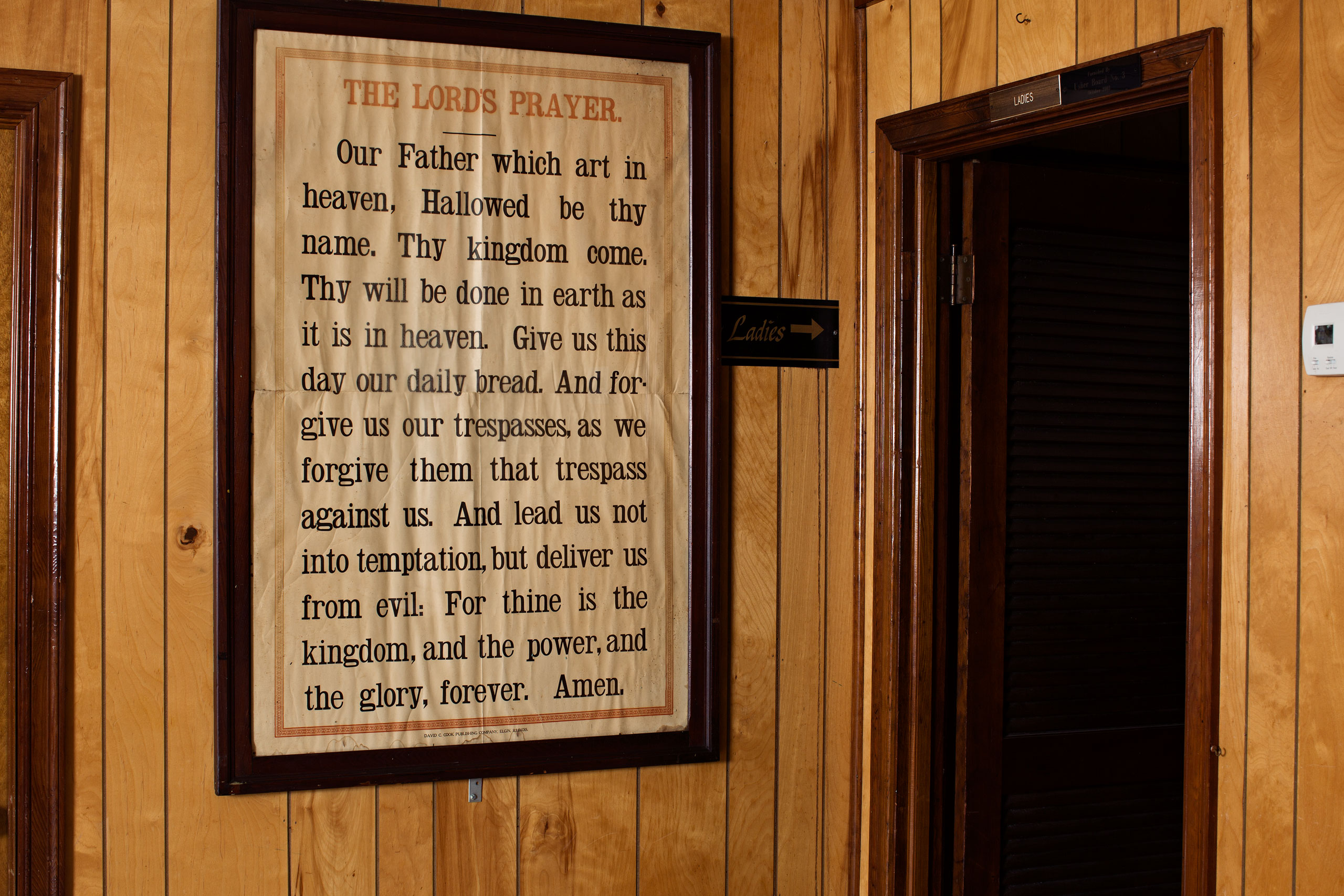 The Lord's Prayer hangs on a wall inside Mother Emanuel
