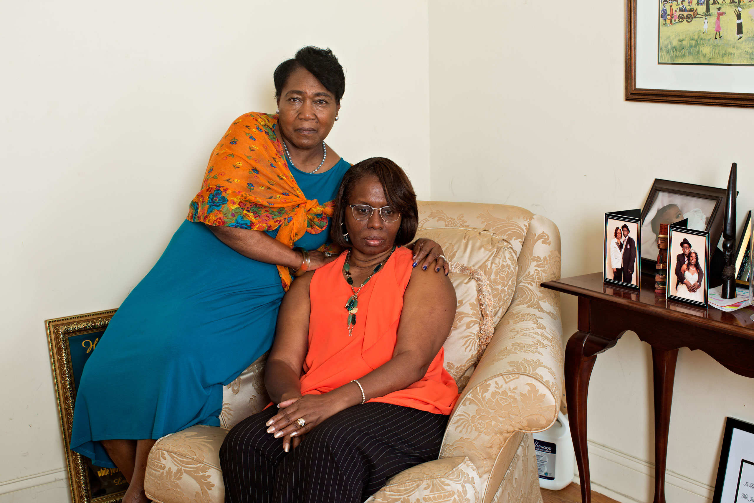 Polly Sheppard, left, and Felicia Sanders. The longtime friends, seen at Sanders' Charleston home, both survived the massacre. The killer spared Sheppard at gunpoint so she would tell what happened.