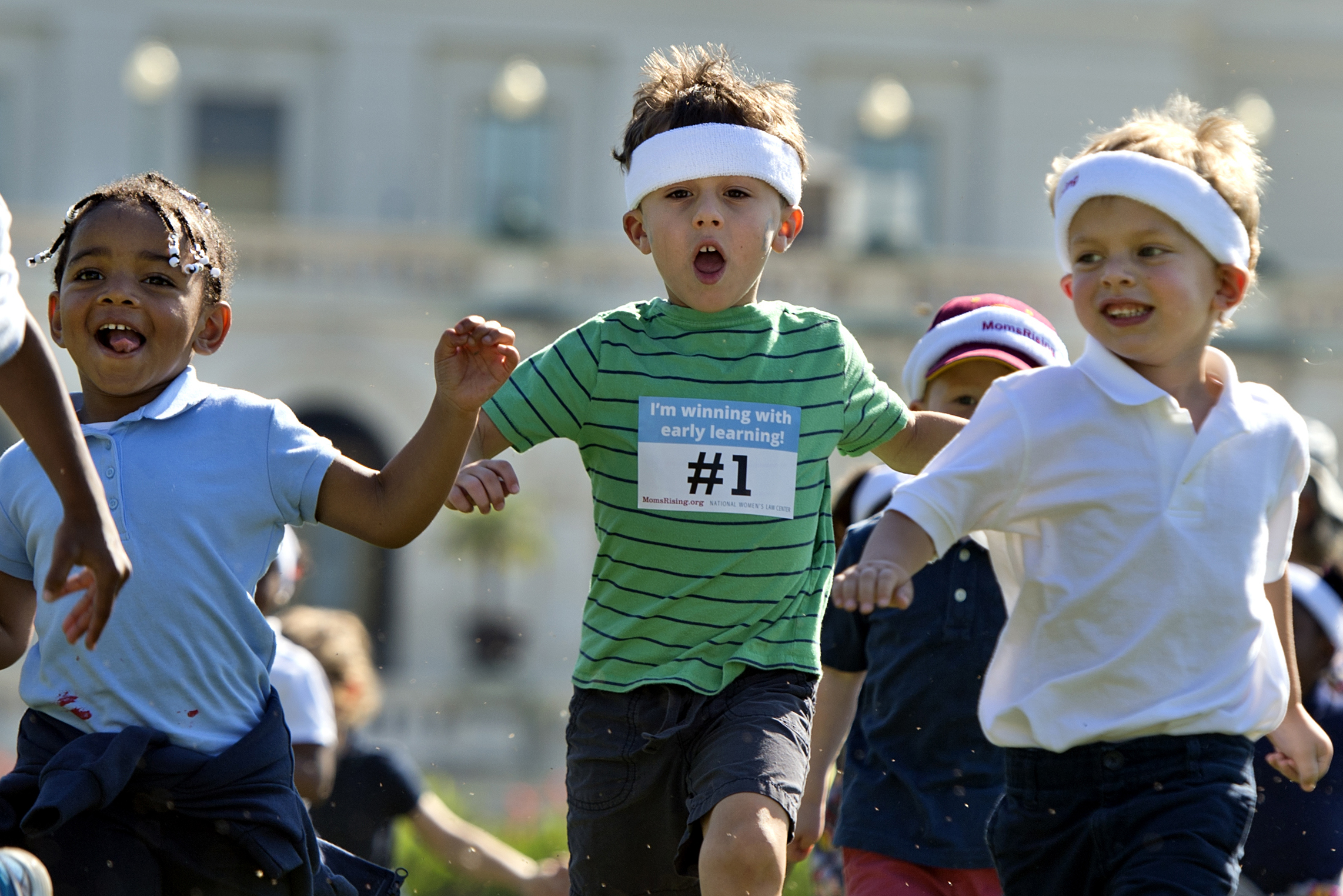 Children run a relay race during an event sponsored by co-hosted by MomsRising and the National Women's Law Center to highlight the importance of affordable child care and early learning programs on Sept. 17, 2015.
