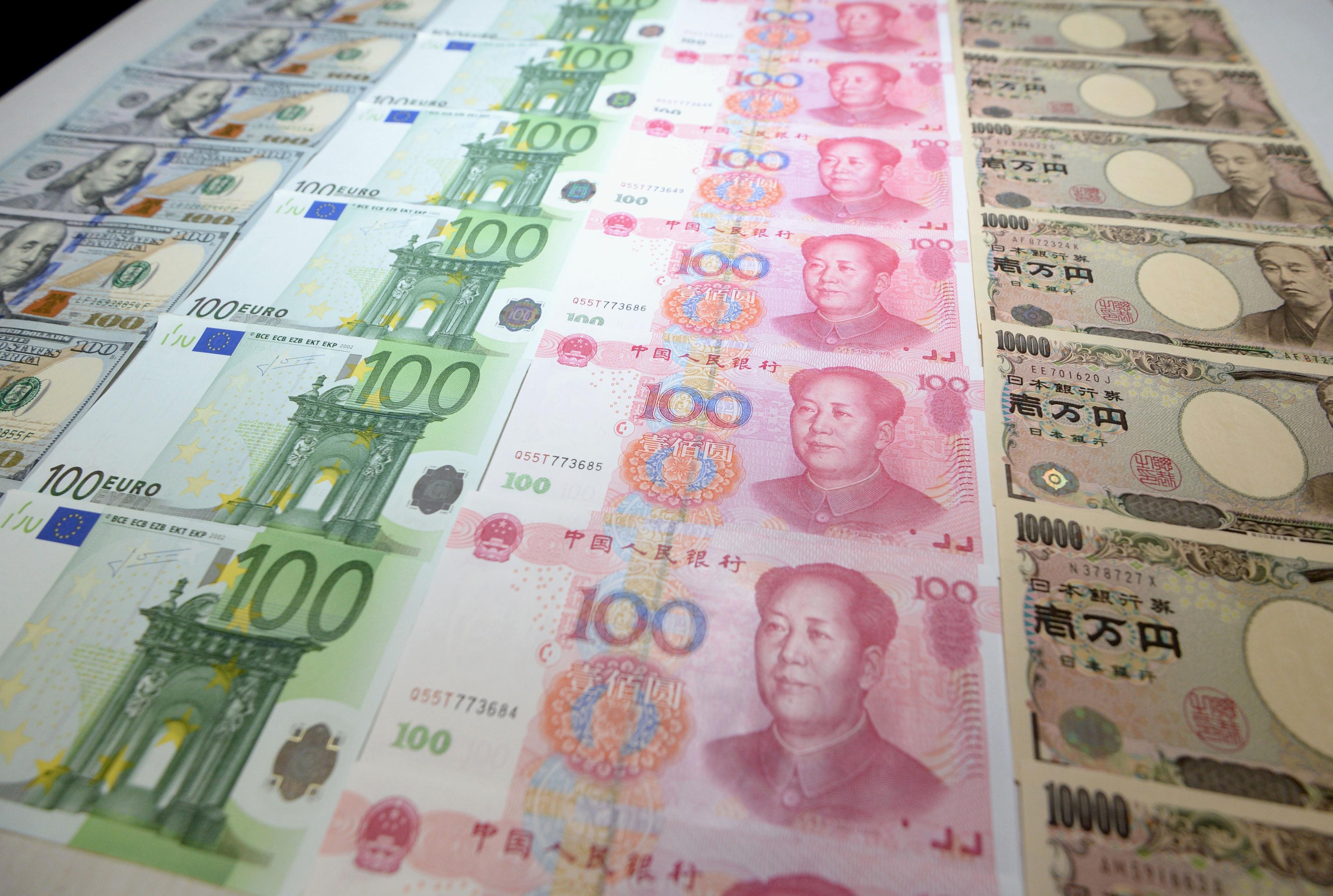 Rows of U.S. dollar, euro, Chinese yuan, and Japanese yen bills, Nov. 30, 2015.