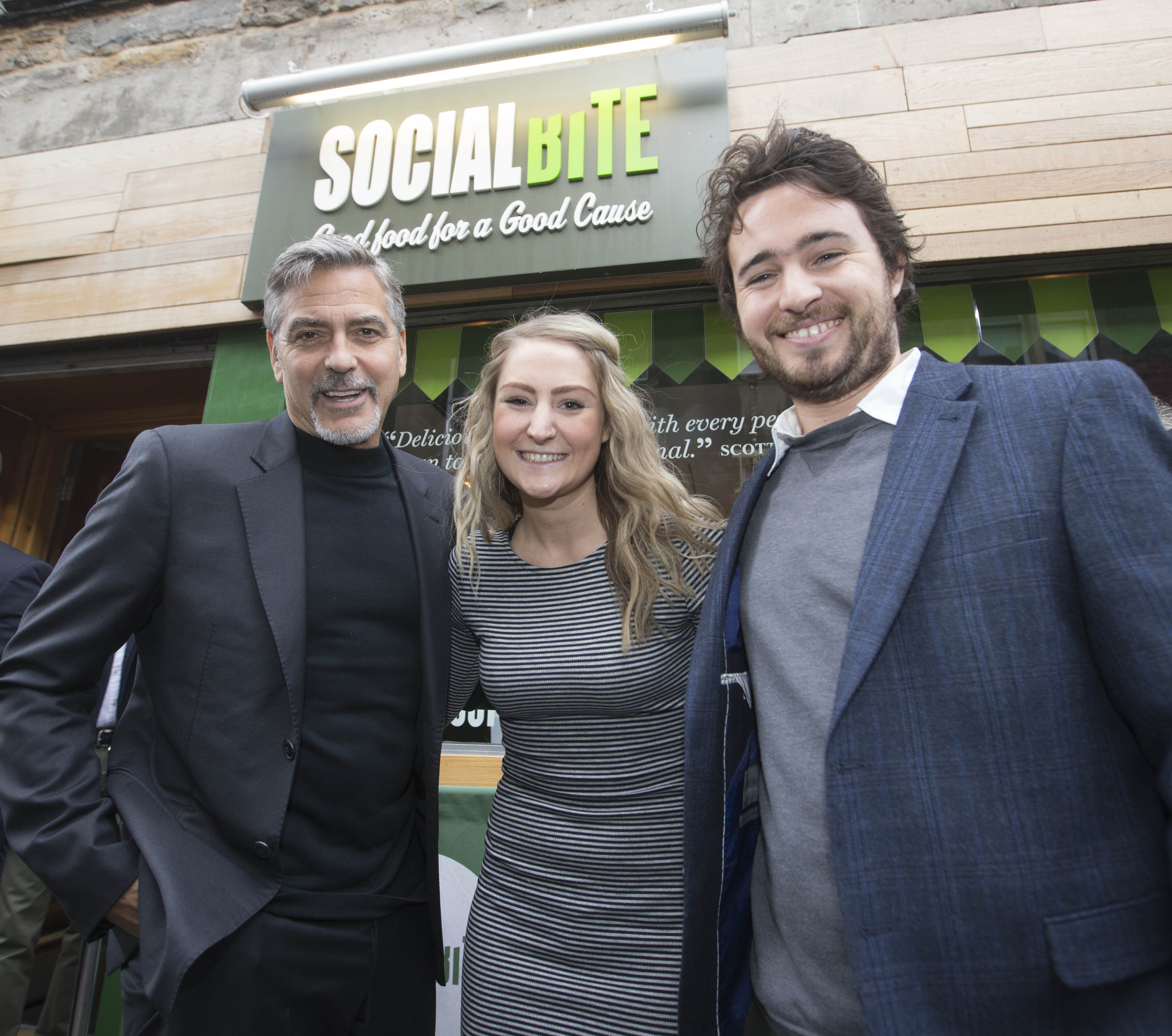 From left: George Clooney, and Social Bite co-founders Alice Thompson and Josh Littlejohn in Edinburgh, Scotland on Nov. 12, 2015.
