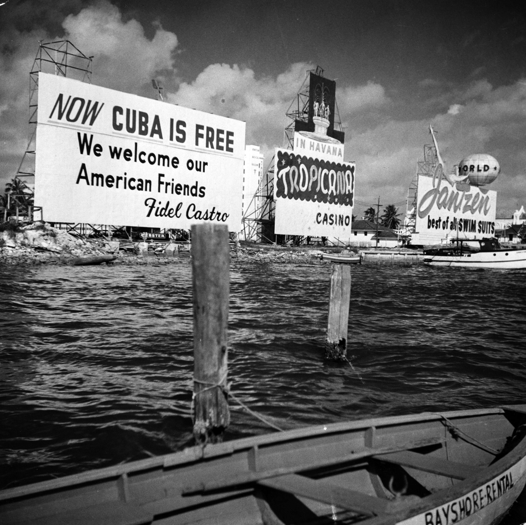 A sign on the Miami waterfront invites Americans to visit Cuba in 1960.