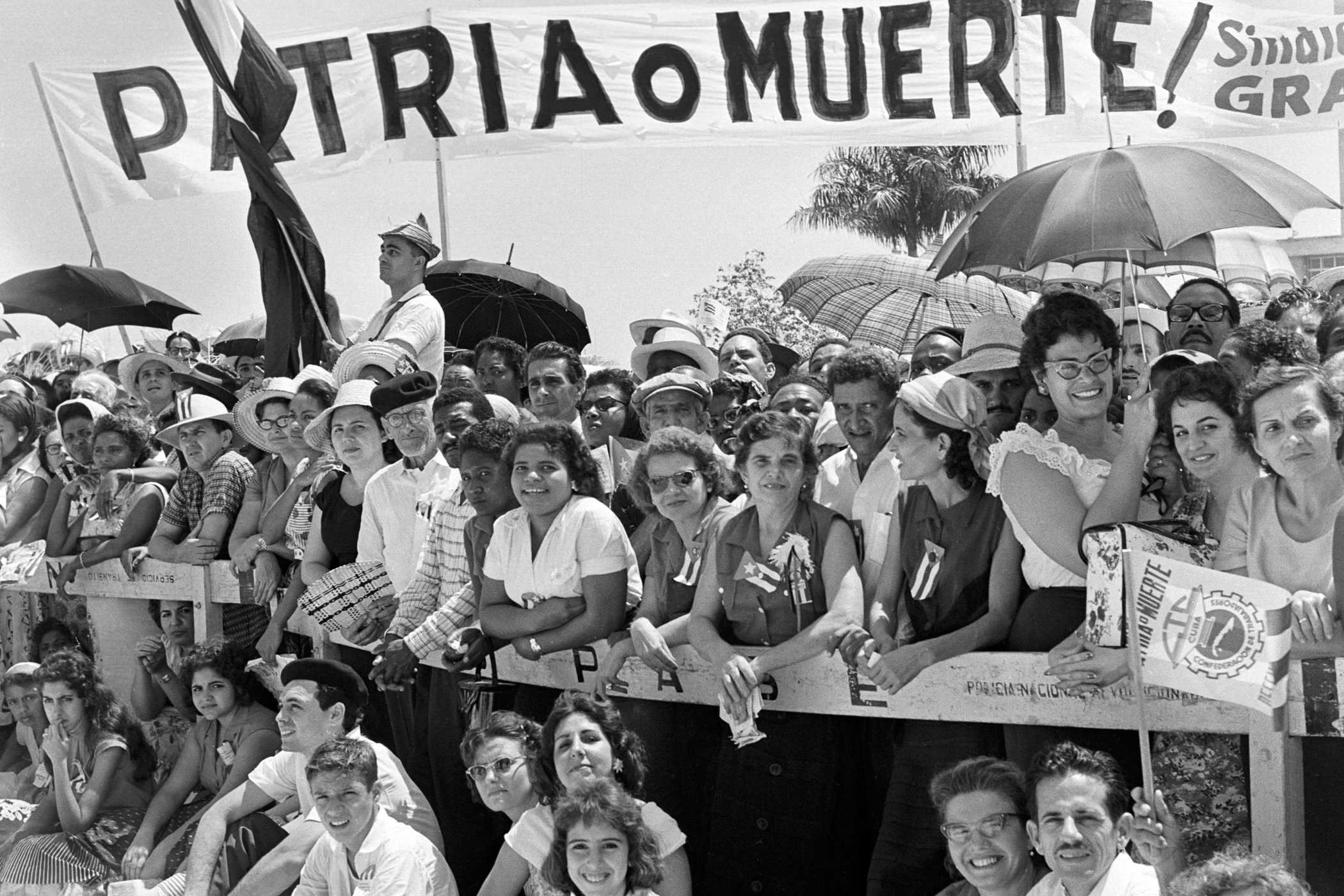 Cubans watch the May Day parade at the Plaza de la Revolucion in Havana on May 1, 1960.