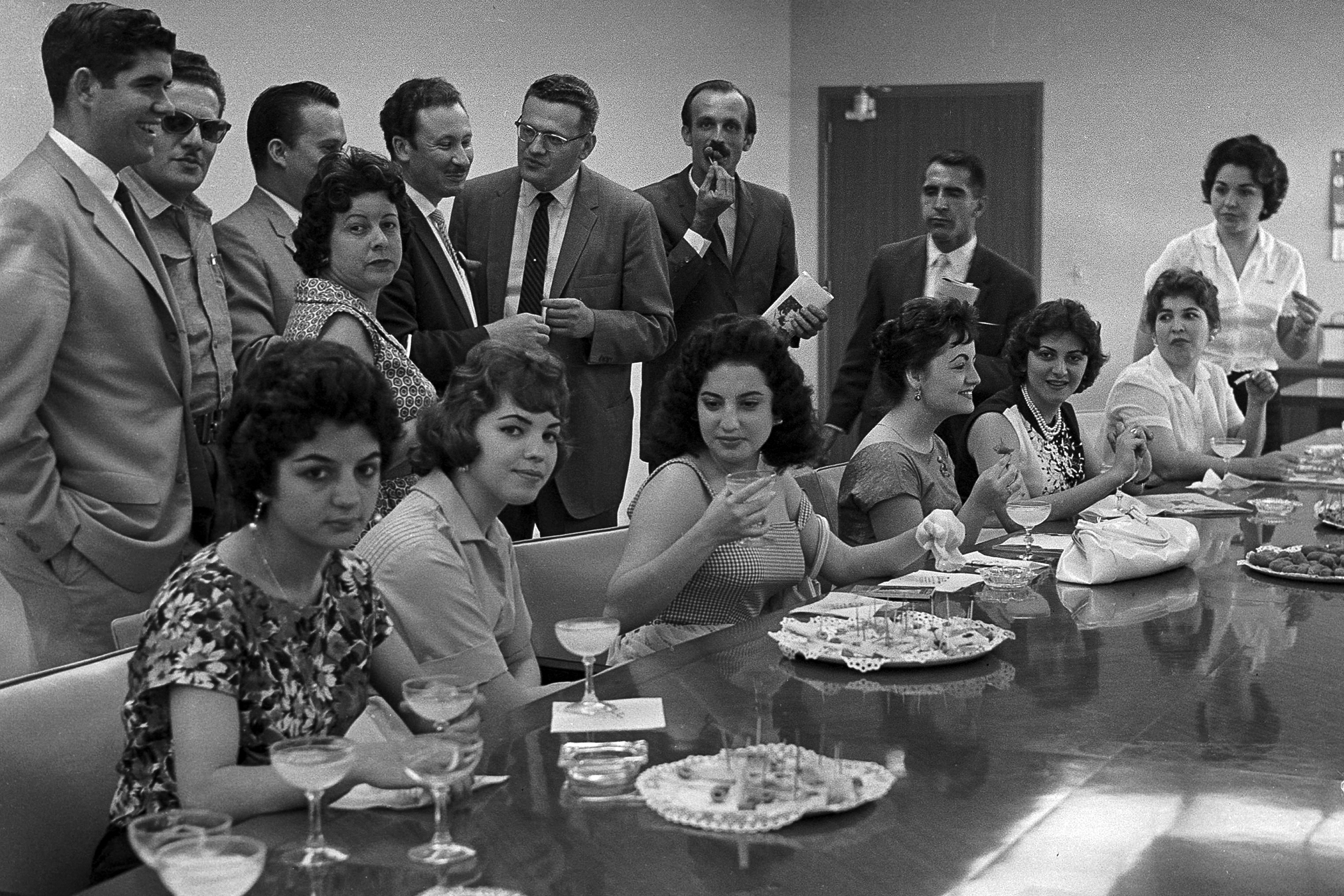 People attend a meeting at the National Institute for Agrarian Reform in Havana in January 1961.