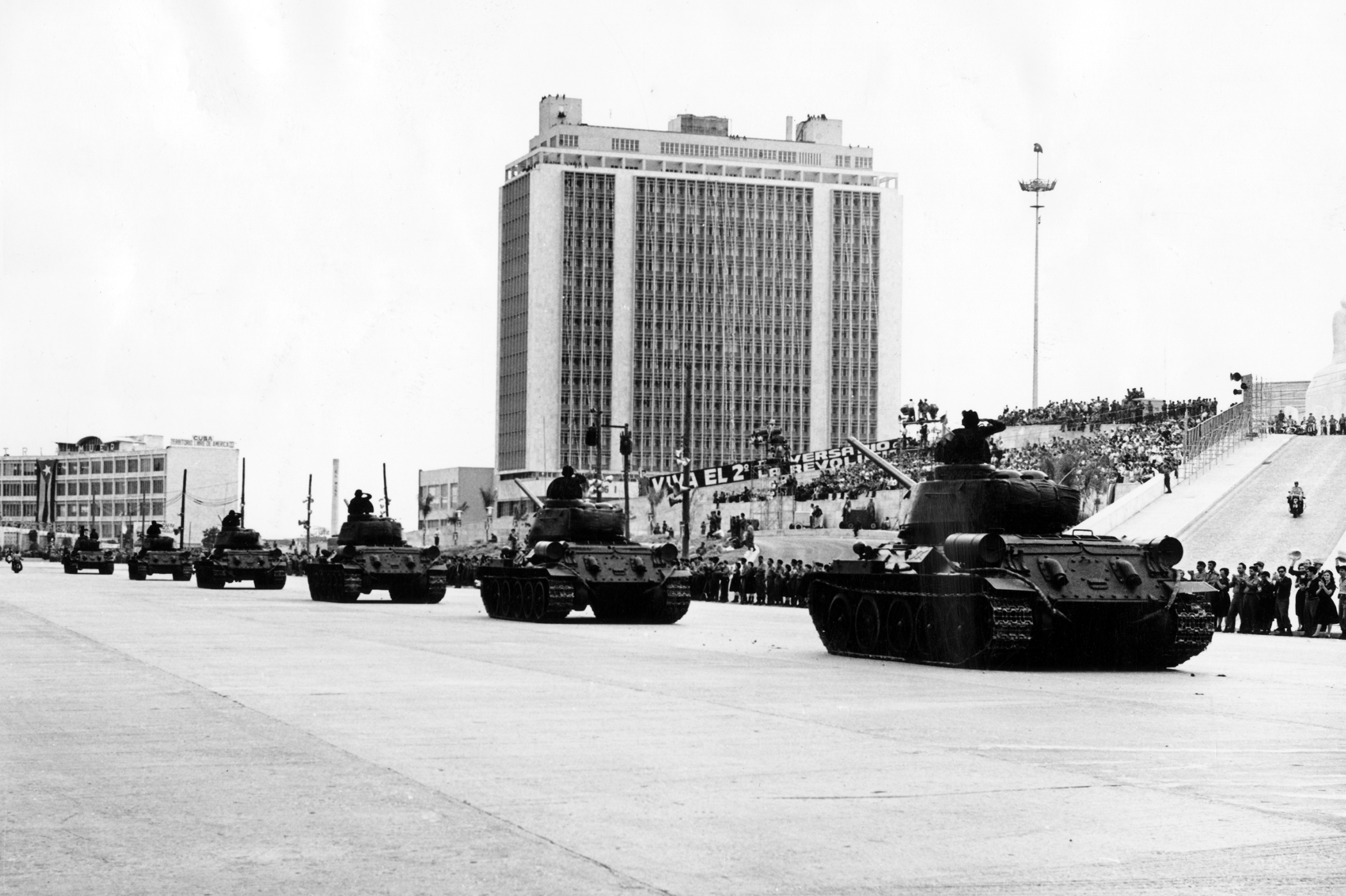 Tanks pass in a military parade on the second anniversary of the Cuban Revolution at Plaza Marti in Havana in  January 1961.