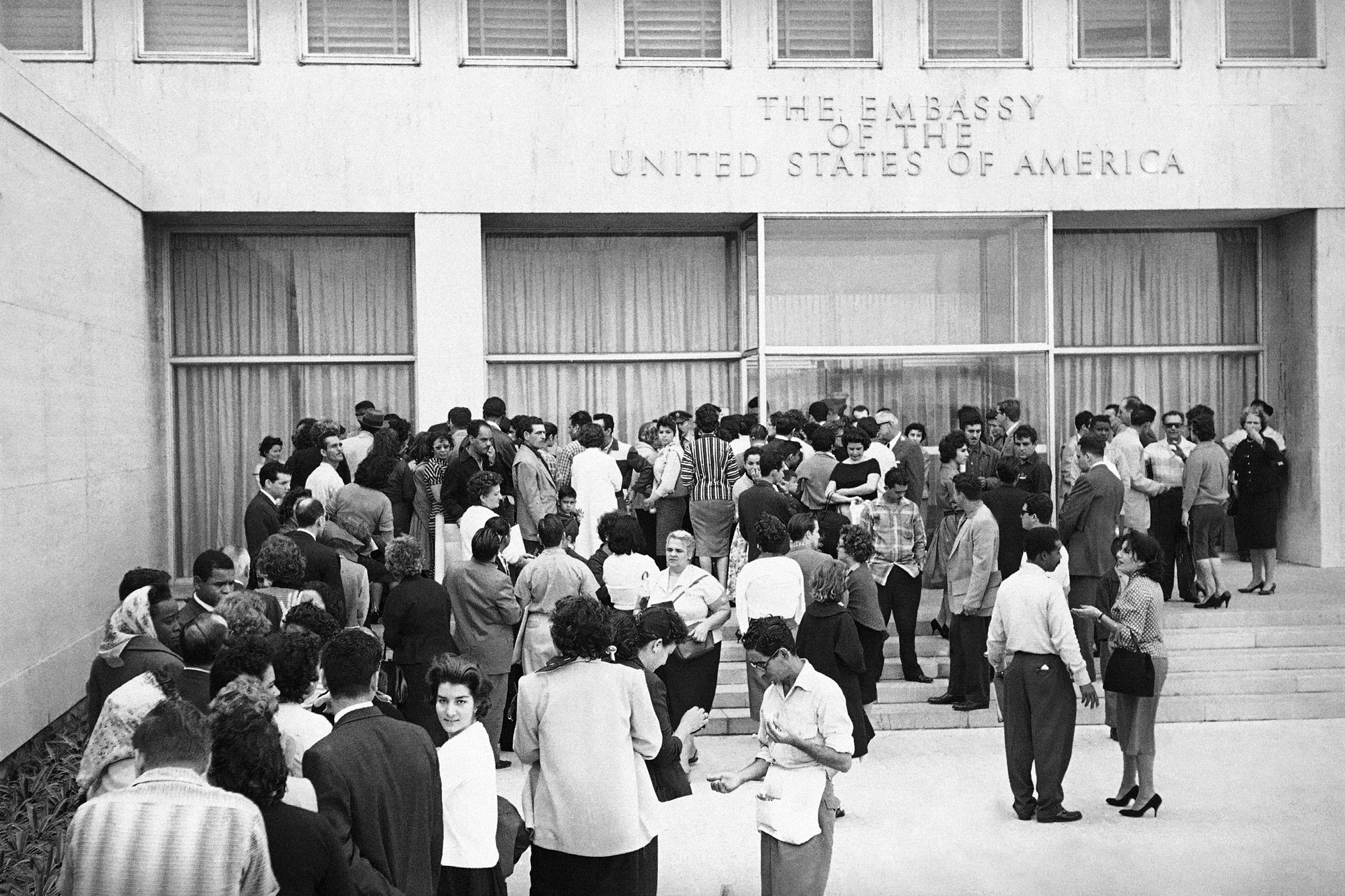 Cubans queue outside the U.S. embassy in hopes of obtaining visas after President Fidel Castro ordered the embassy to reduce its staff in Havana on  Jan. 3, 1961. After the diplomatic break in 1961, Washington was without a presence in Cuba until 1977.
