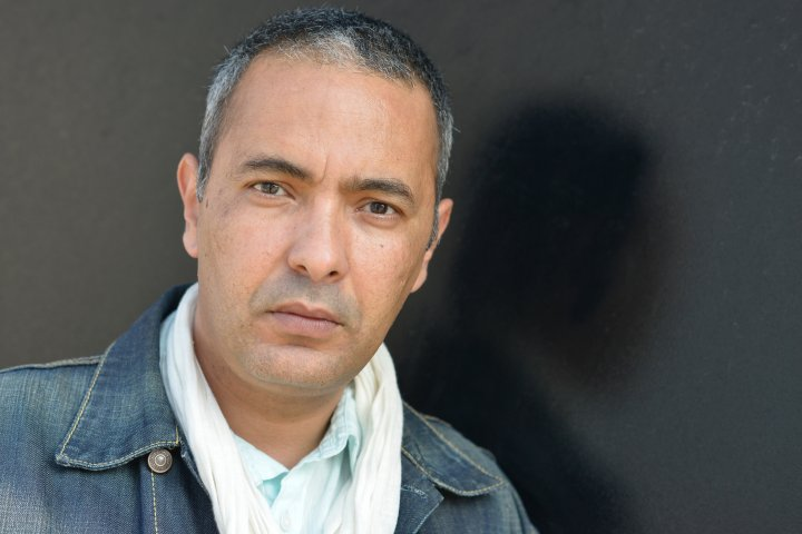 Kamel Daoud, Algerian journalist and writer poses during portrait session held in Saint Malo, France, on May 24, 2015.