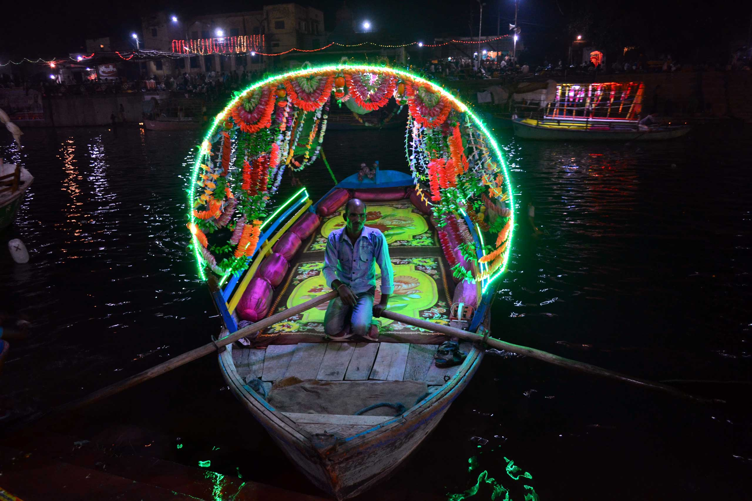 An Indian boatman waits for customers in Chitrakoot, India, on Nov. 11,2015.