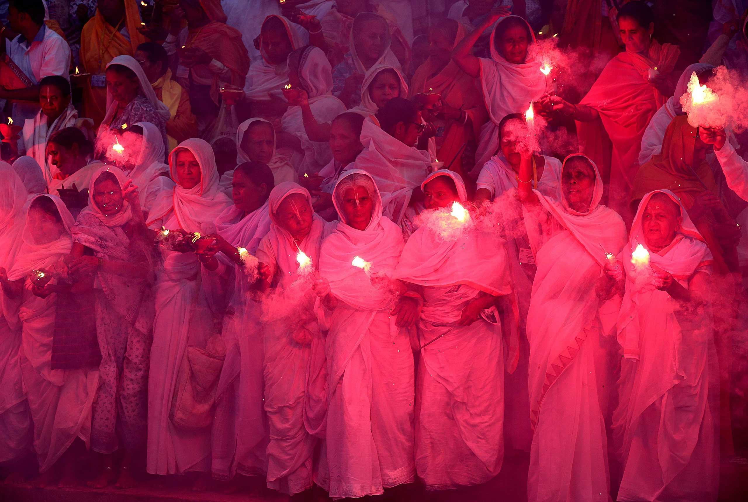 Indian widows burn fire crackers as they participate in an event to mark Diwali in Vrindavan, 100 miles  from New Delhi, on Nov. 10,  2015.