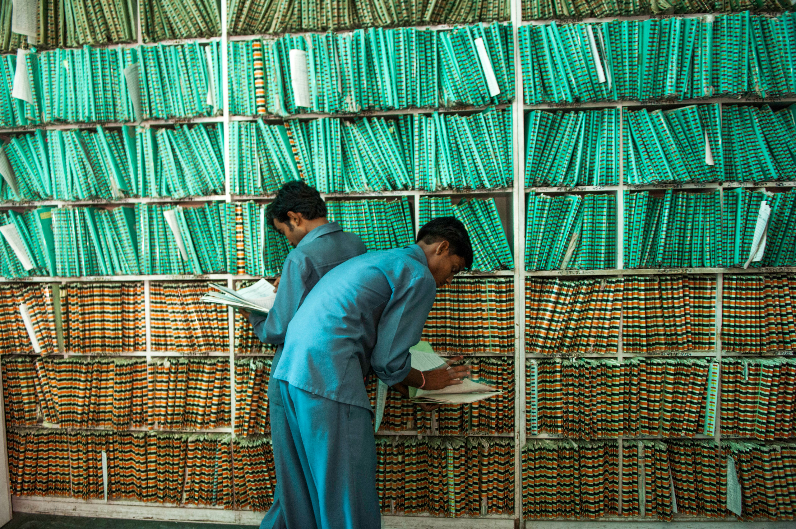 Medical assistants review files at the Cancer Hospital. Jaipur, Rajasthan, 2009