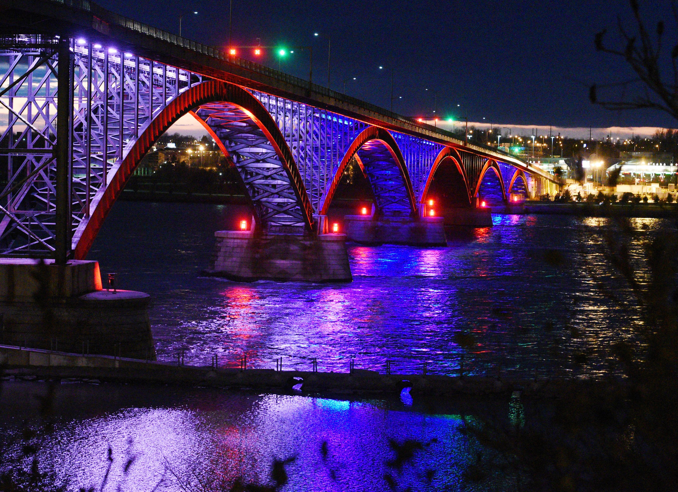 The International Peace Bridge, which connects Canada and the United States, glows with the colors of the French flag in honor of the victims of the Paris attacks,  in Buffalo, NY Nov. 14, 2015.