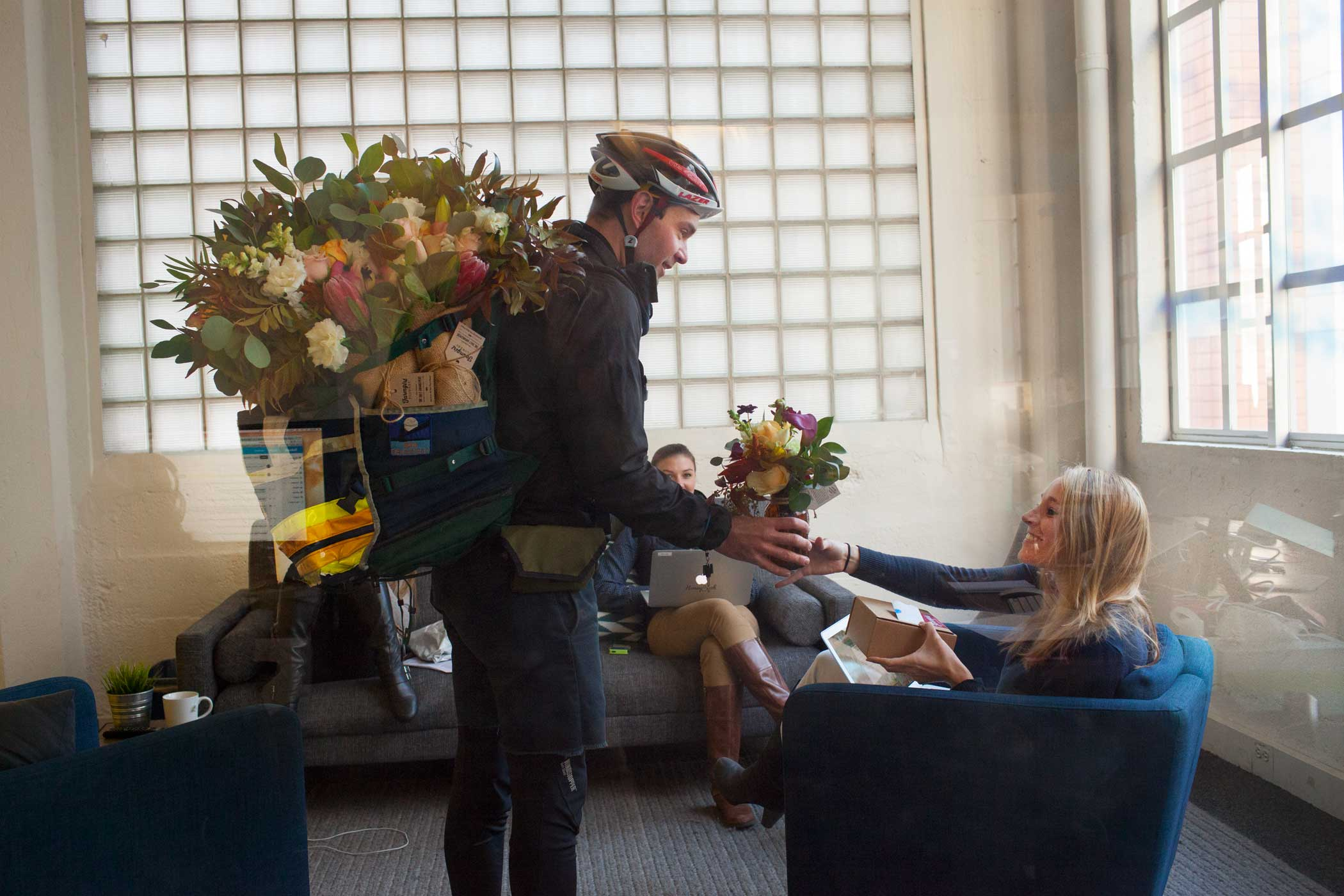 A Farmgirl Flower's customer receives a surprise bouquet delivery.