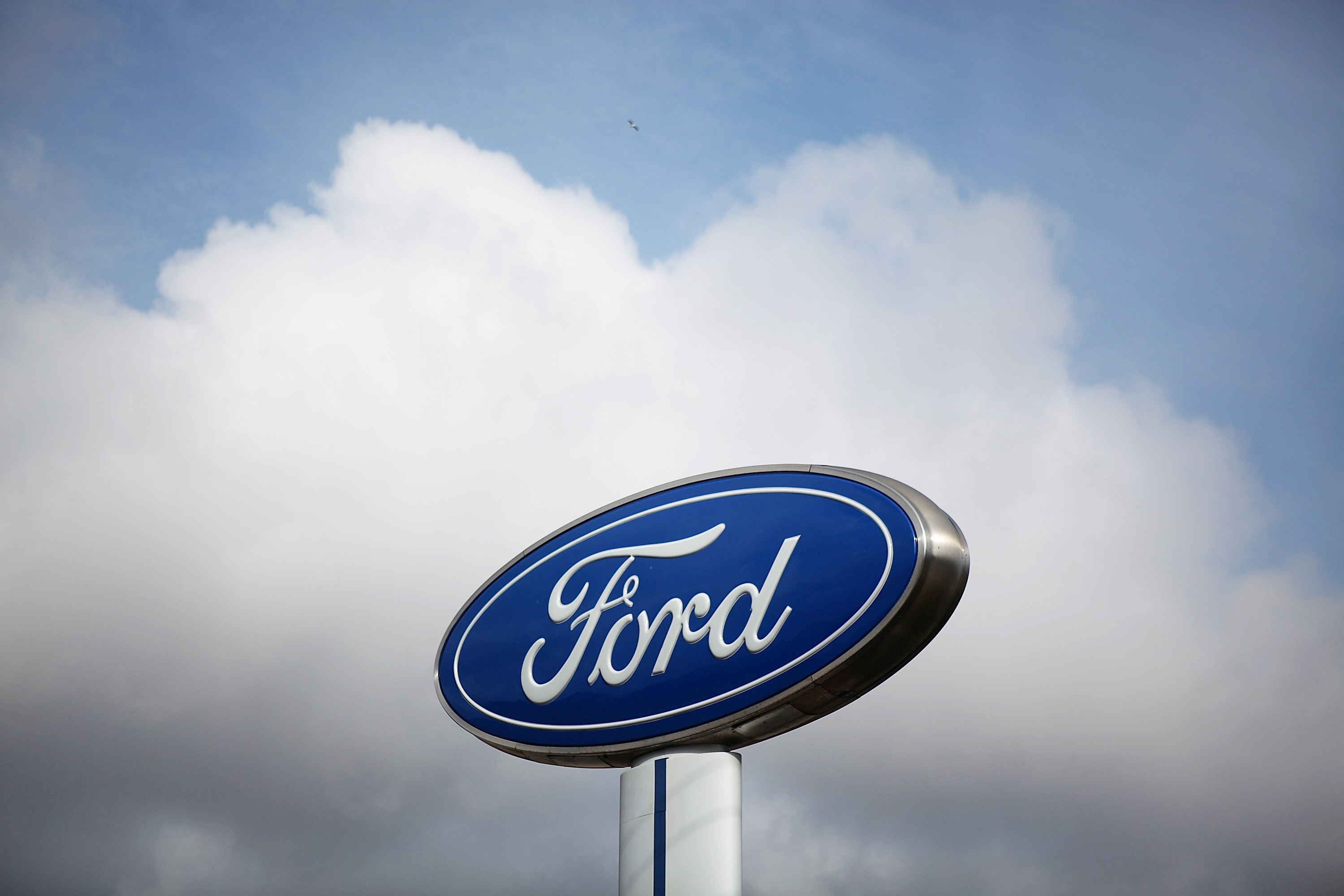 The Ford logo is displayed in front of Serramonte Ford in Colma, Calif. on Feb. 23, 2011.