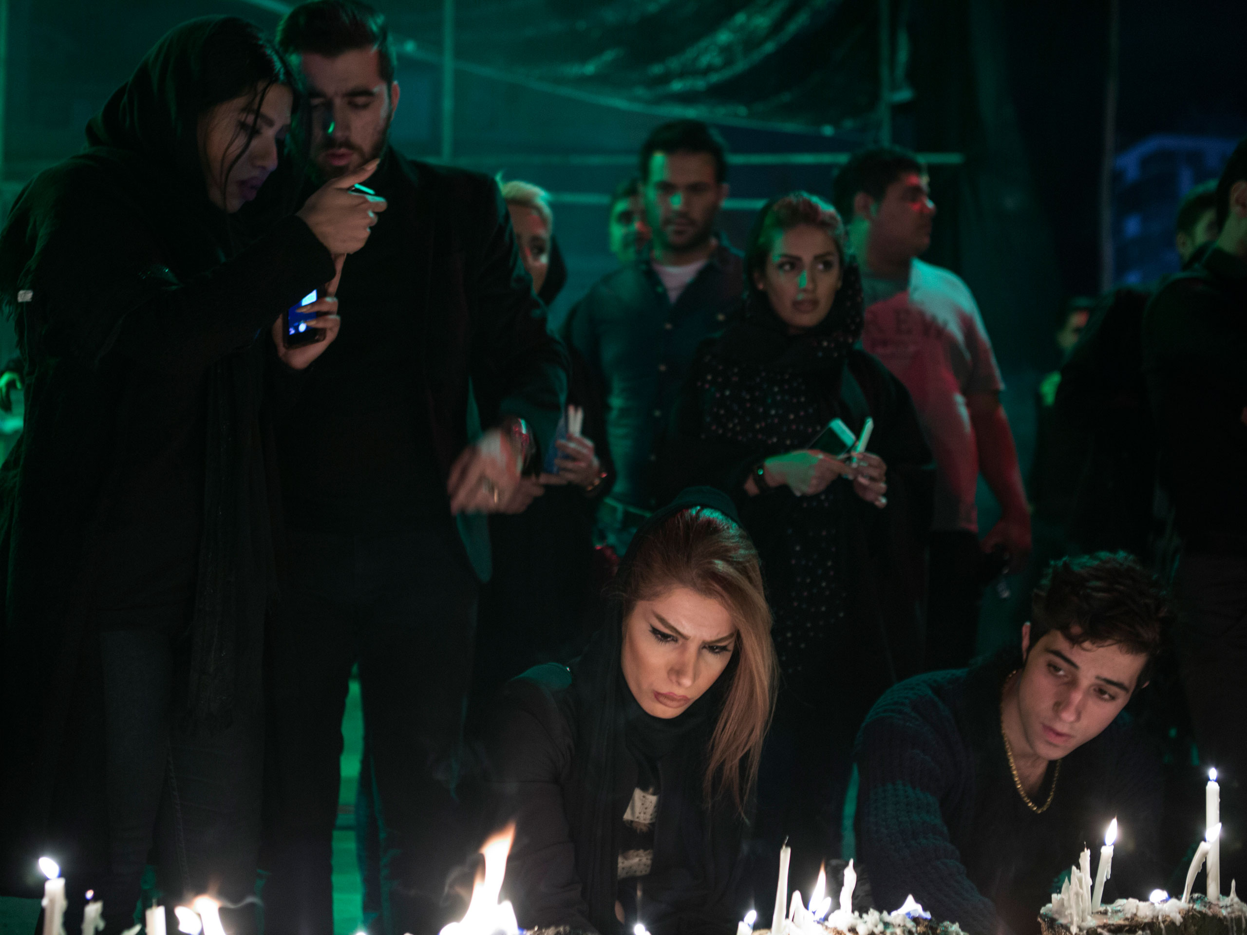 Iranian women light candles to commemorate the death of the revered Shiite martyr, Imam Hussein, grandson of the  Prophet Mohammad.                               His violent death on the plains of Kerbala, Iraq, is remembered during the mourning period known as Ashura.