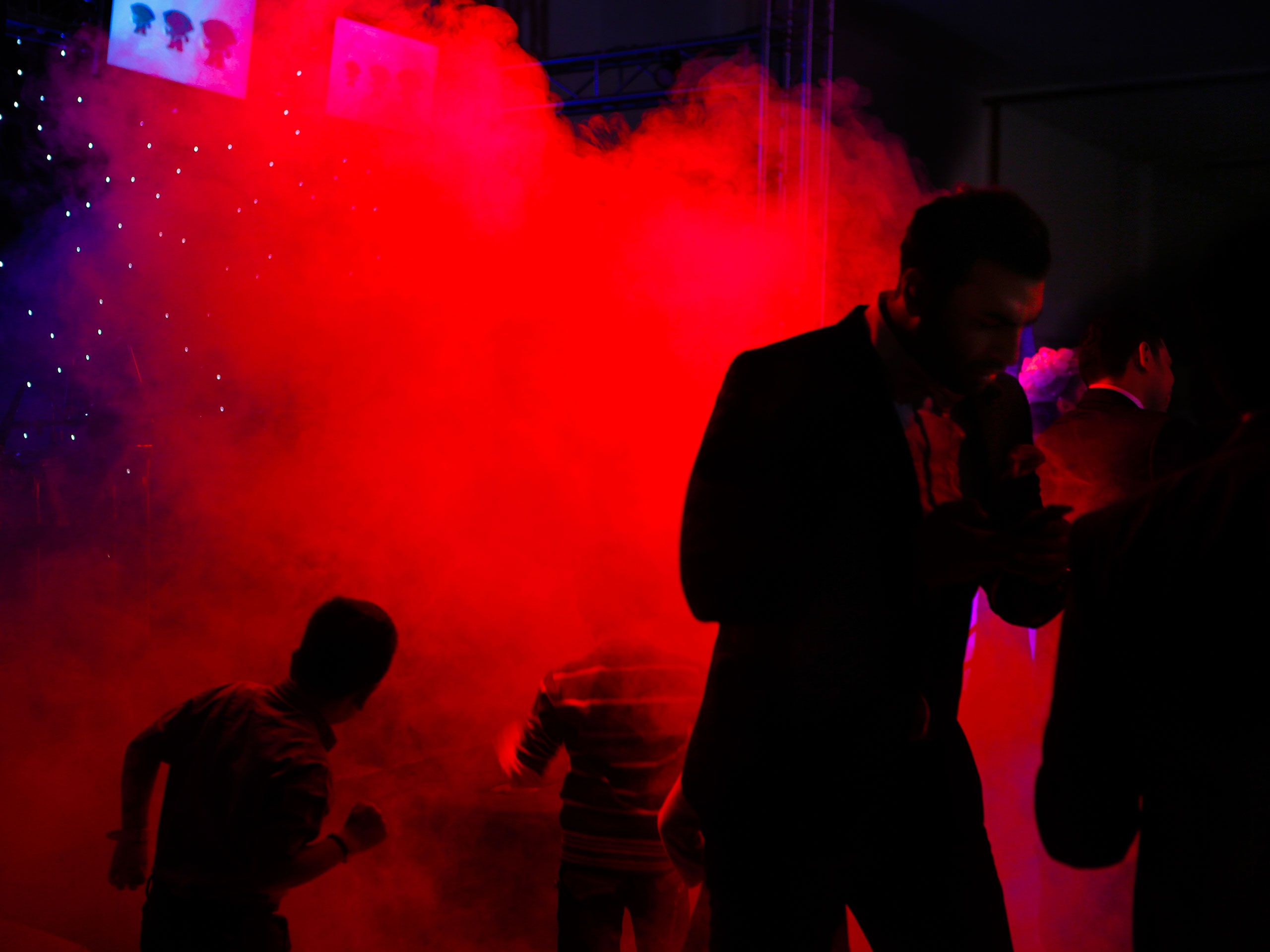 Men dance at a wedding in an illegal - but tolerated - wedding hall in Karaj, a satellite town of the capital.