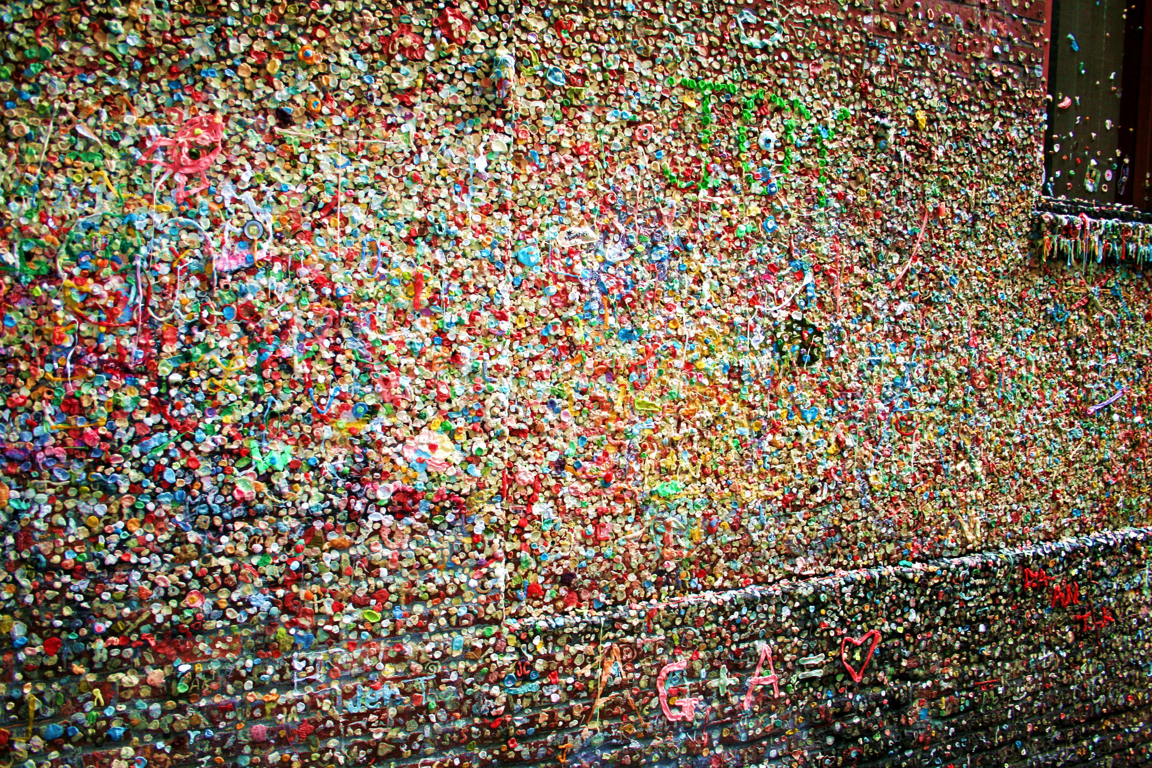 Tourists from all over the world have come to stick chewing gum to a wall on Post Alley near Pike Place Market in Seattle.