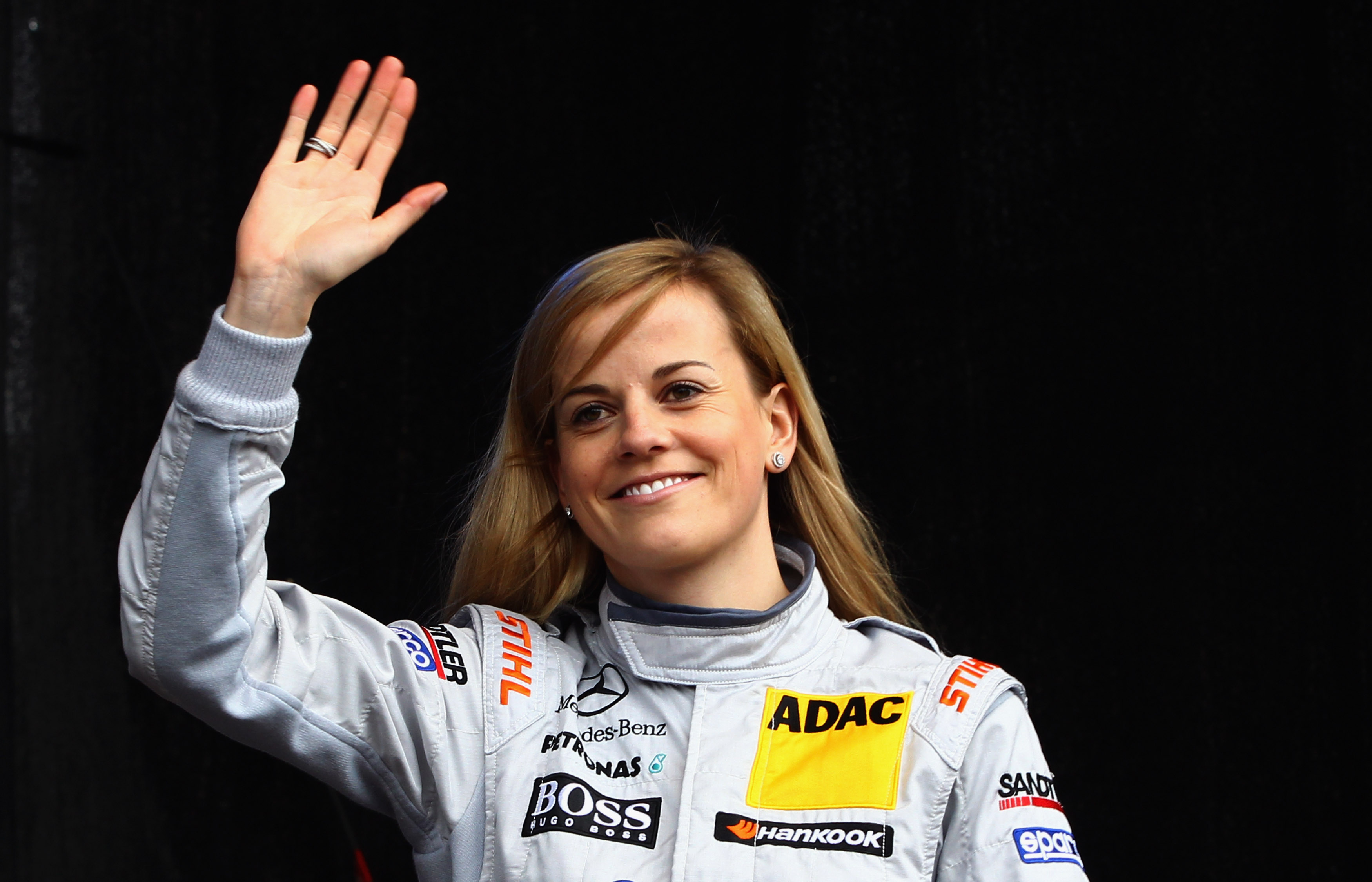 British Mercedes driver Susie Wolff waves during the DTM touring car presentation on April 22, 2012 in Wiesbaden, Germany.