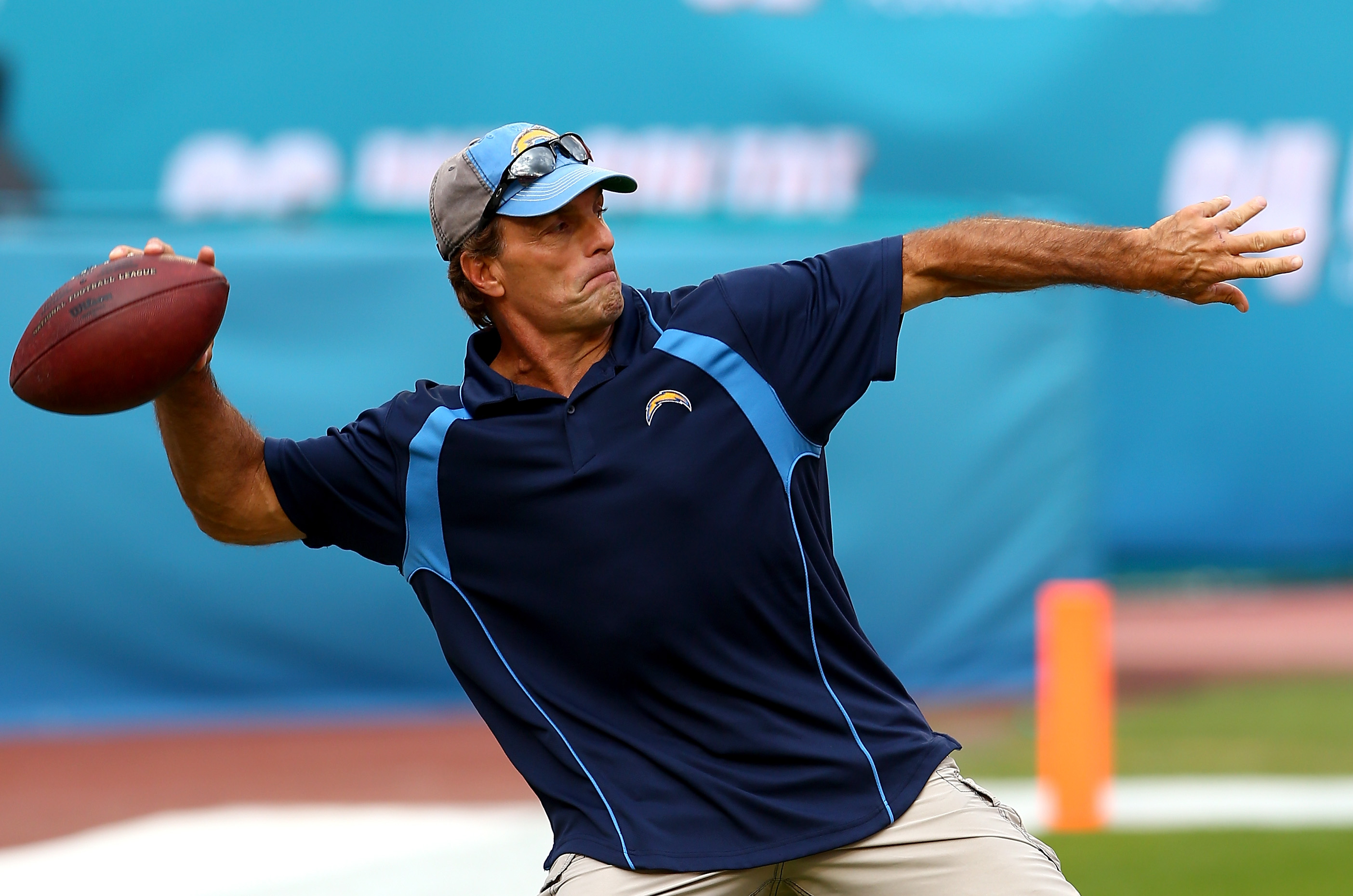 Former NFL quarterback, Doug Flutie, throws a ball during warmups before the game between the San Diego Chargers and Miami Dolphins at Sun Life Stadium on November 17, 2013 in Miami Gardens, Florida.