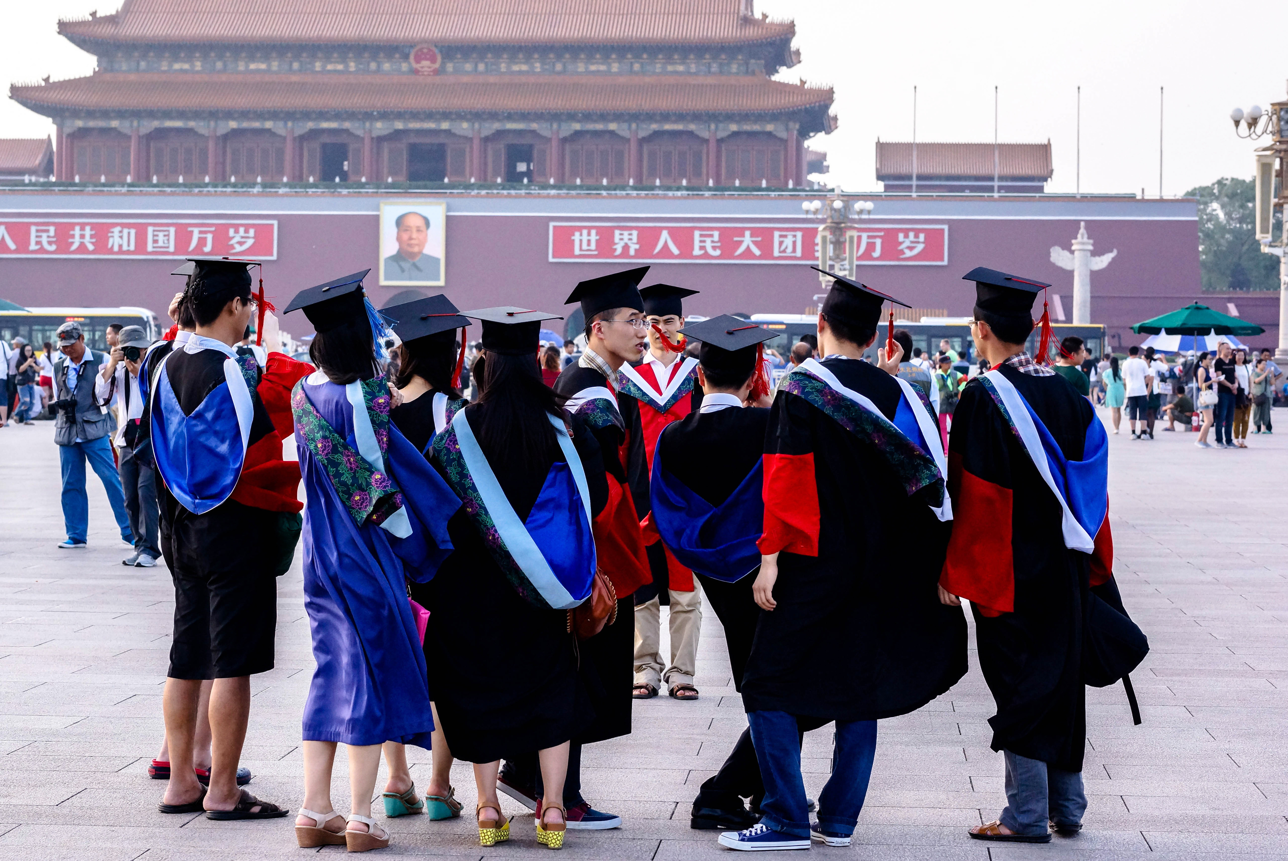Graduates from Peking Union Medical College take commemorative photos in Tienanmen Square, Beijing, China, June 19, 2014