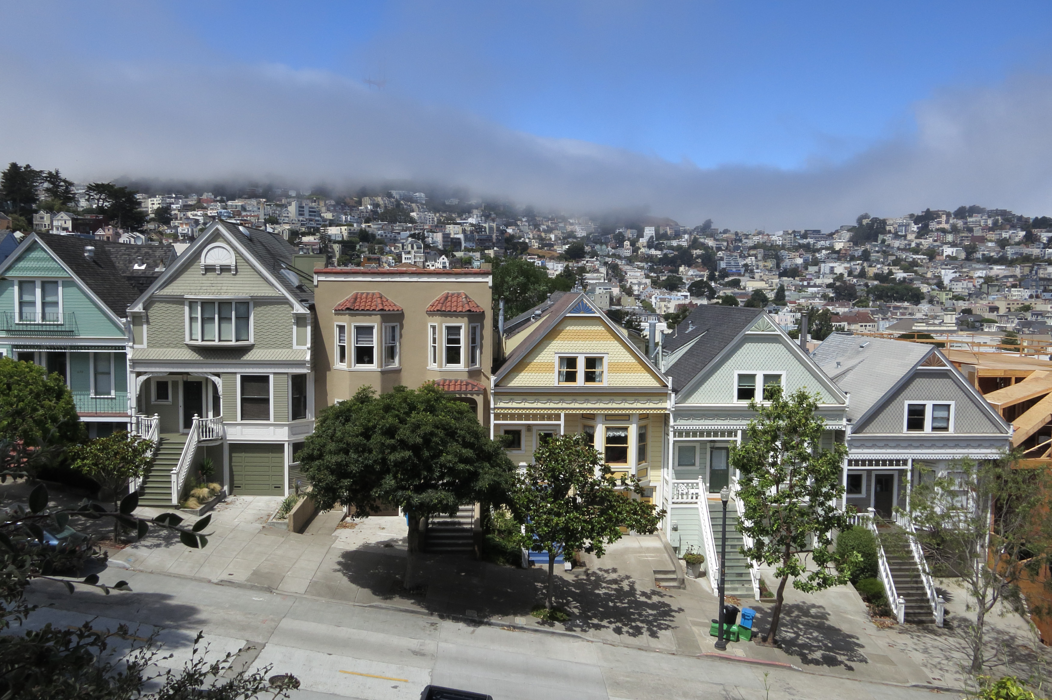Residential houses line a street in Mission district near Delores Park as typical summer fog rolls in on July 4, 2014 in San Francisco, California.