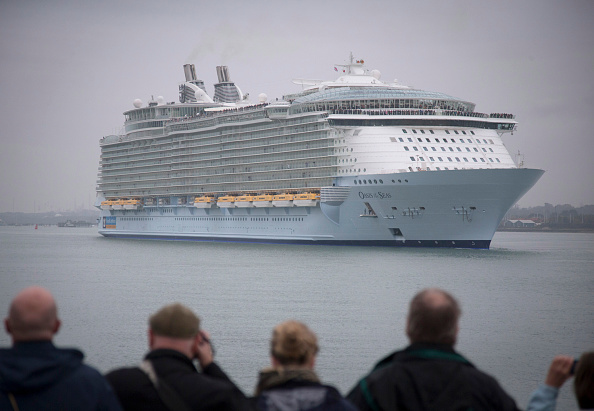 People gather on the waterfront to watch the world's largest cruise ship 'Oasis of the Seas' as she arrives in Southampton Water on Oct. 15, 2014 in Southampton, England