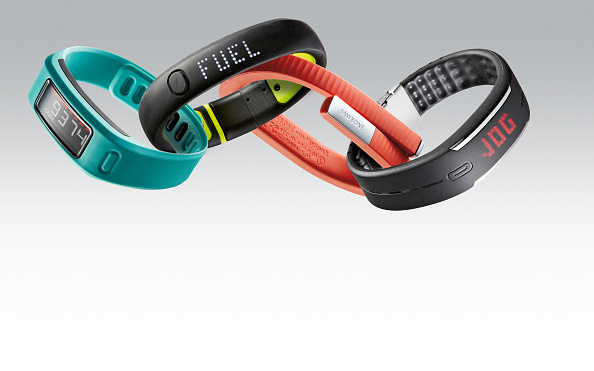 A selection of fitness tracker bracelets, including (L-R) a Garmin Vivofit, Nike FuelBand SE, Jawbone UP24 and Polar Loop, taken on March 27, 2014. (Photo by Neil Godwin/T3 Magazine via Getty Images)