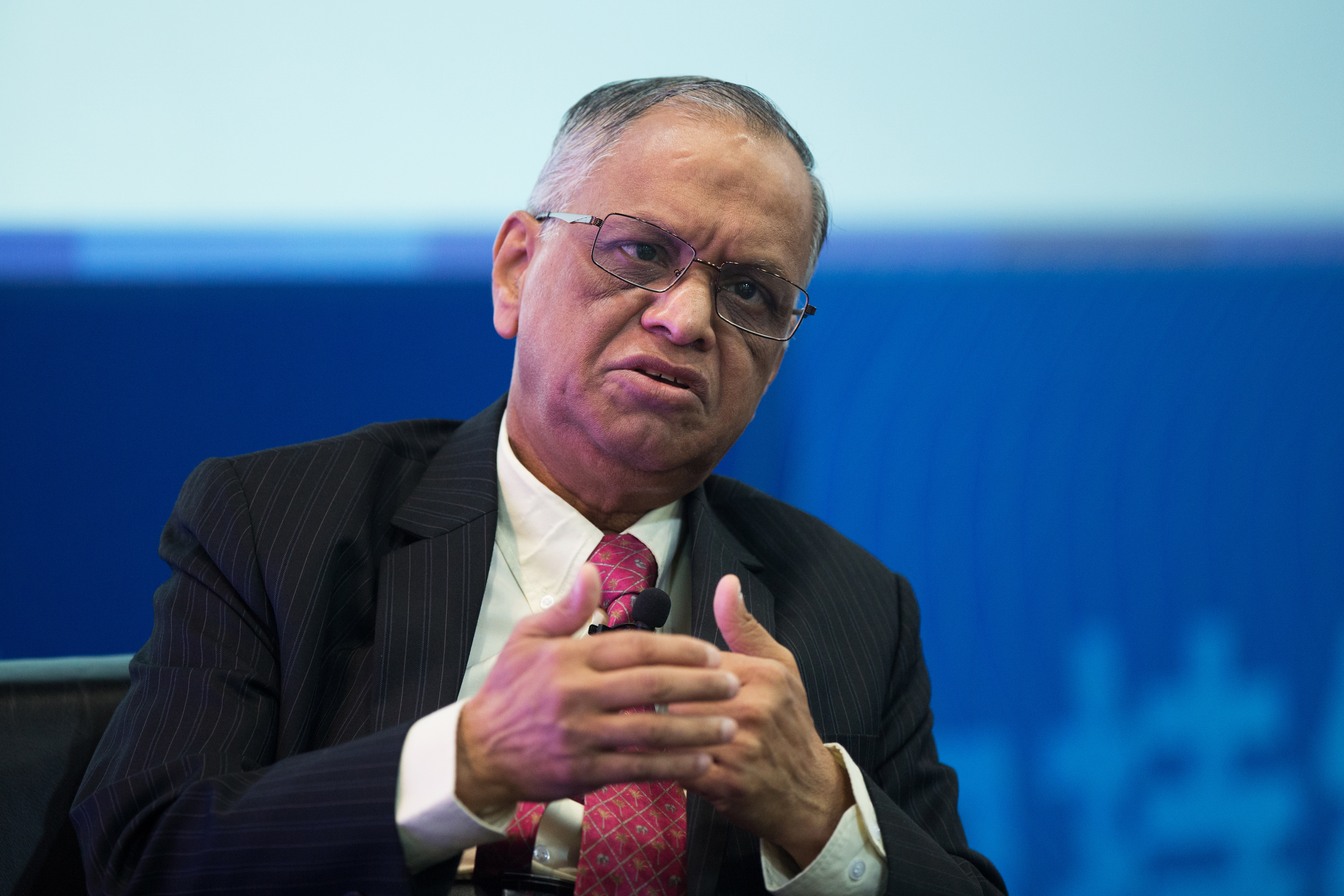 N.R. Narayana Murthy, co-founder and chairman of Infosys, gestures as he speaks during the Hong Kong Asian Financial Forum in Hong Kong on Jan. 19, 2015