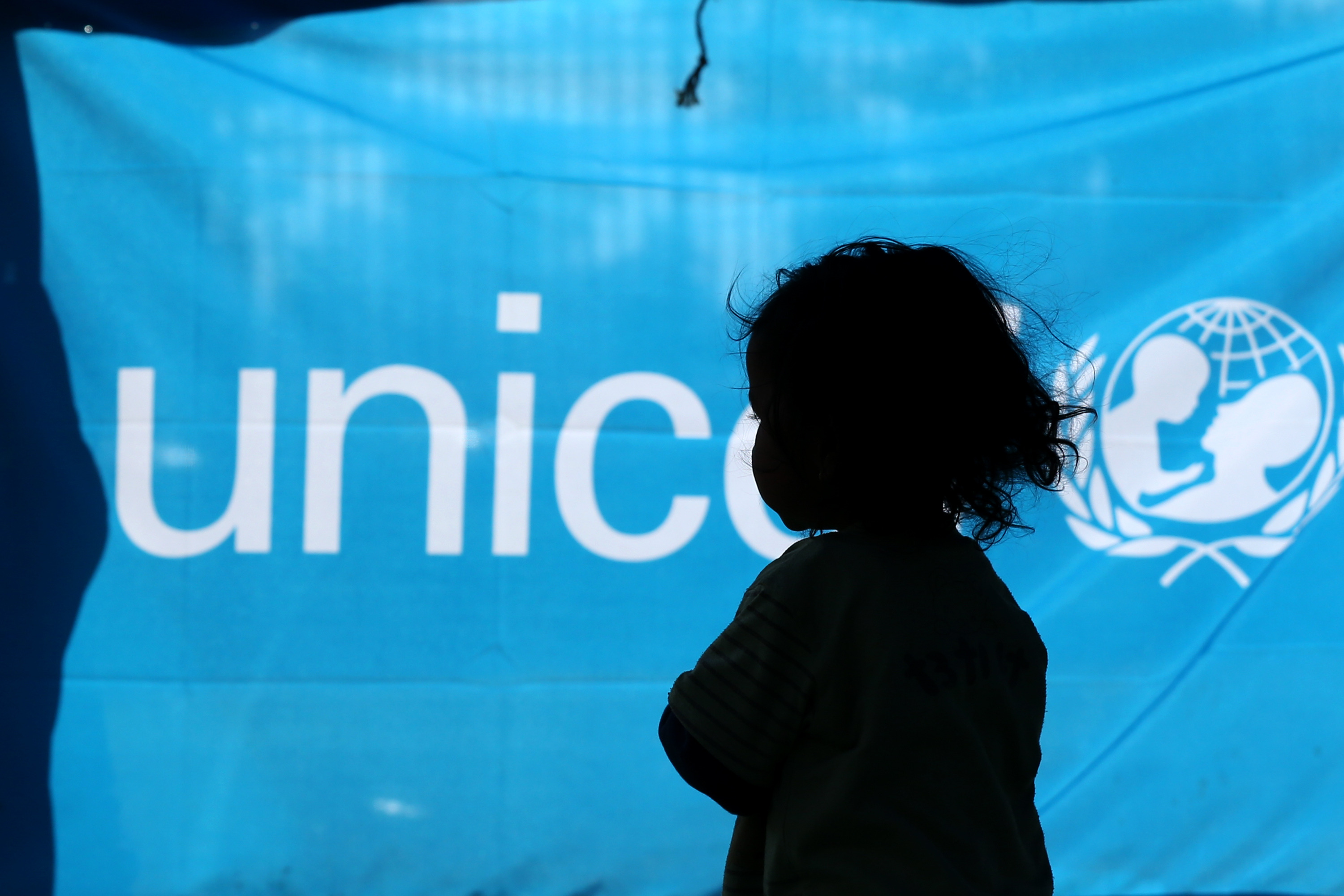 A young girl who was displaced by the earthquake walks inside a UNICEF tent at Tudhikhel makeshift camp in Kathmandu, Nepal on May 4, 2015.